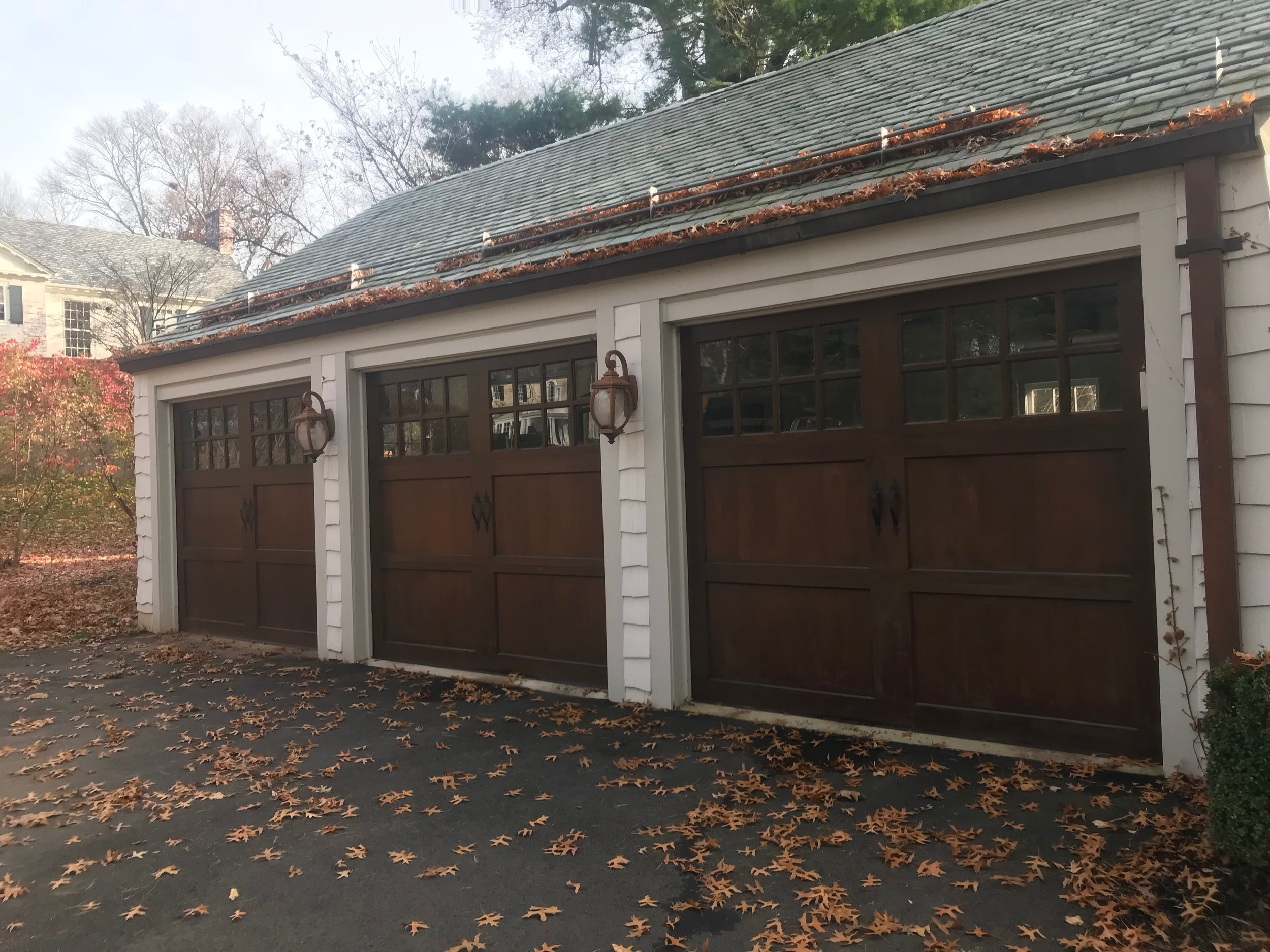 Three Door Wooden Carriage House Style Garage Dark Mahogany Stain with Windows