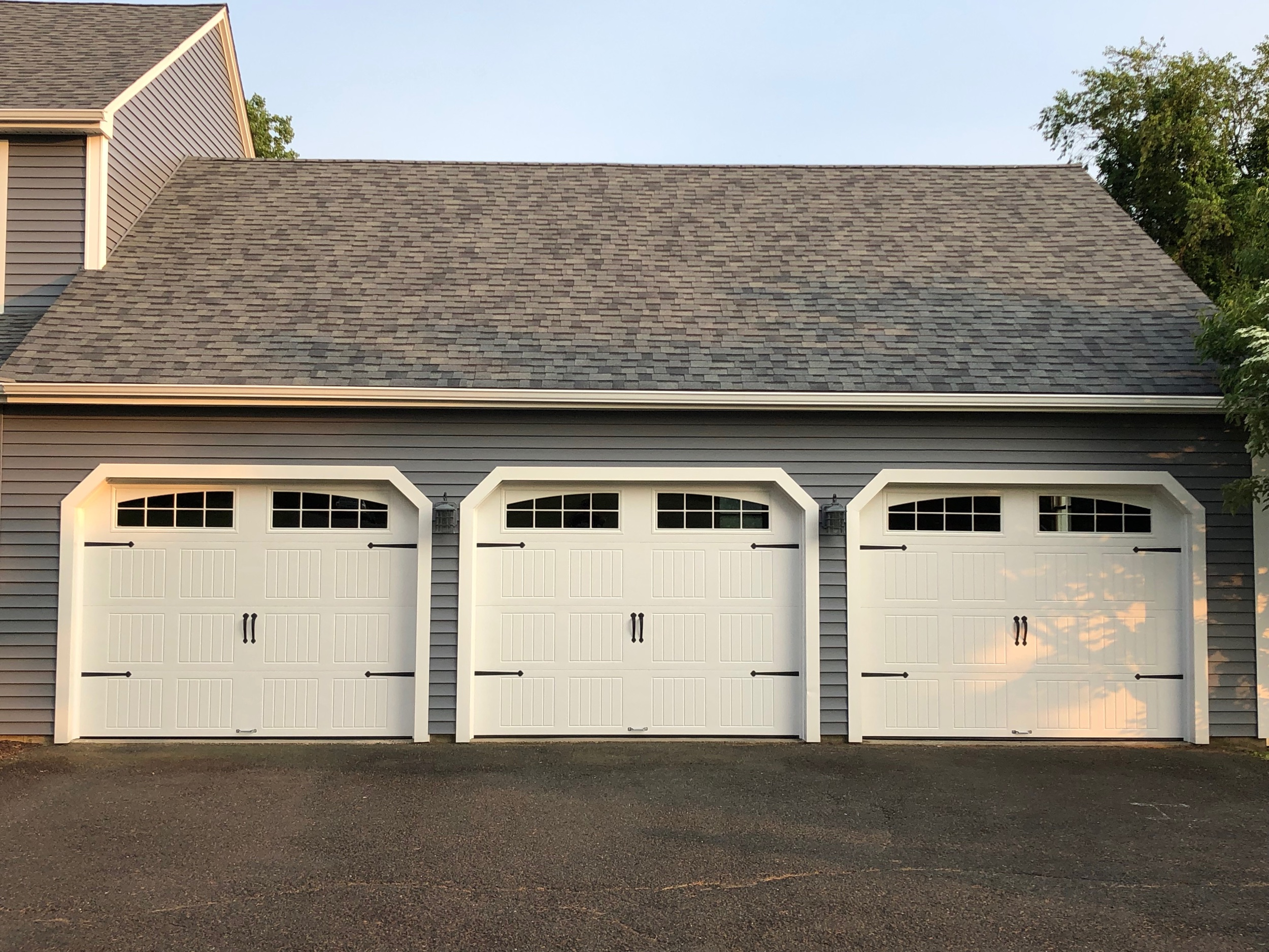 White Carriage House Style Three Door Garage