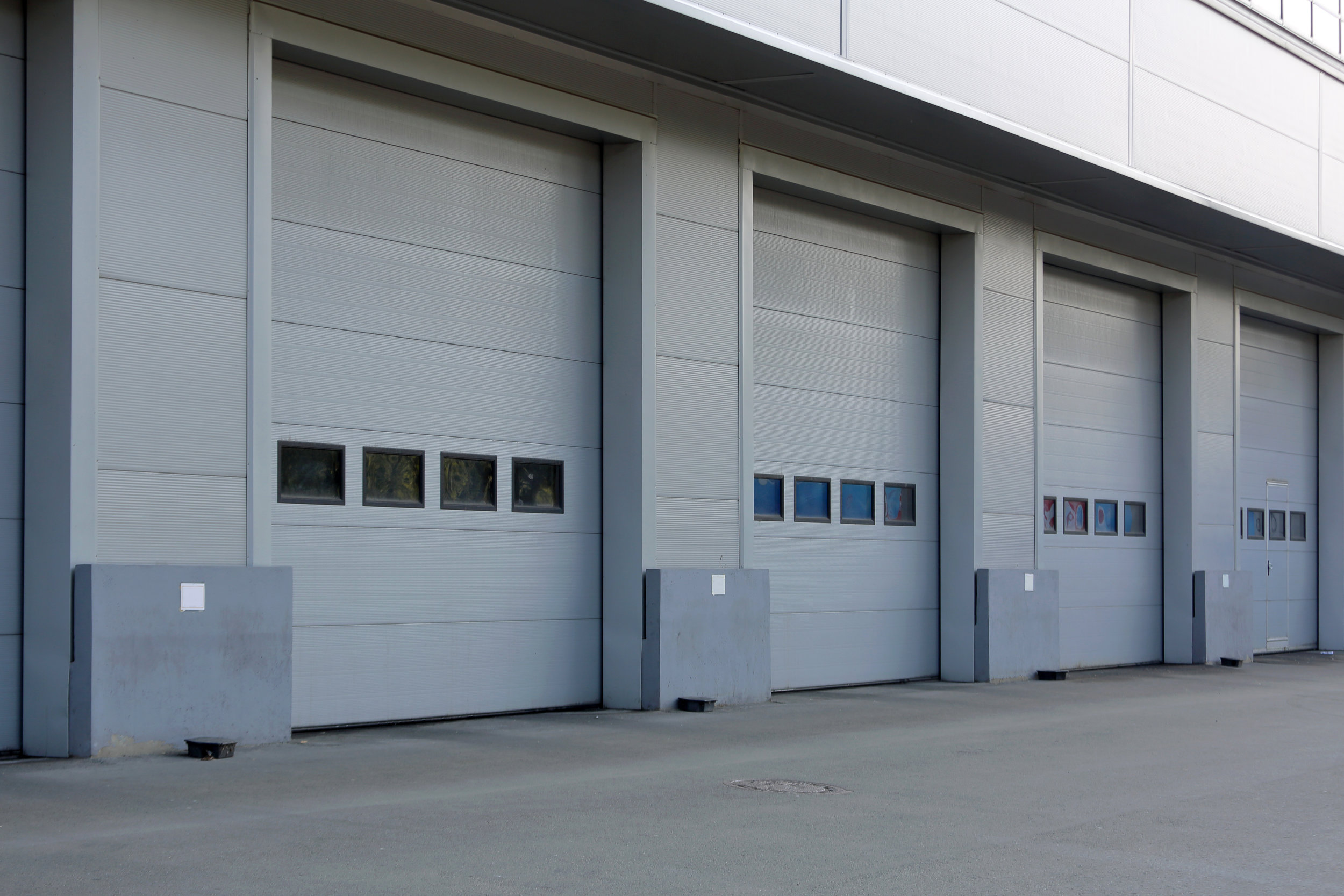 Commercial Garage doors External view white with windows.jpeg