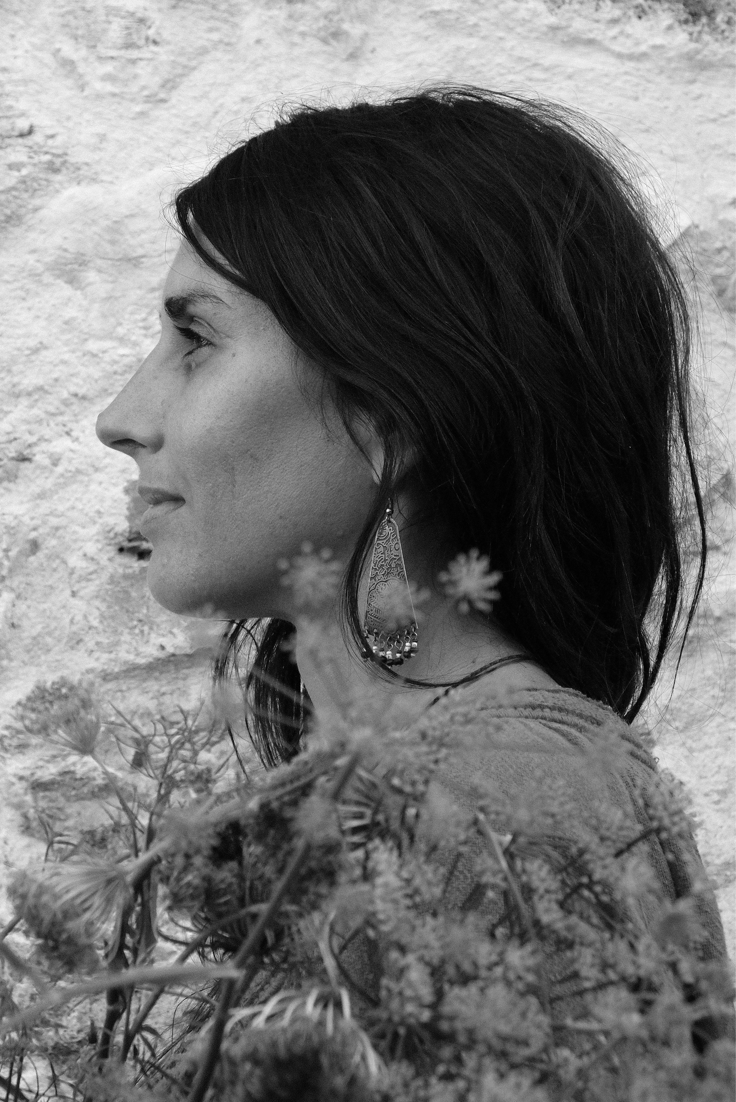 Severine Perron - Severine Perron is a medicine woman and poetess.She supports the resilience and expansion of women, through her art, knowledge of plants and ancient wisdoms, open heart and mother earth, for deep spiritual work on women's lineages and their identity. Path that she herself explored for her own expansion.Poetess, Séverine published a collection of poetry talking about the resilience of women.The community project Les Herbes Vives is the manifestation of her vision to the world, supportive for women who create consciously and manifest intentionally. Regaining their personal power, creativity and responsibility as guardians.Mother of two daughters, natural living is at the heart of her model healing. Individual and collective responsibility, preserving diversity and cultural identity as the basis of a new vision for humanity.