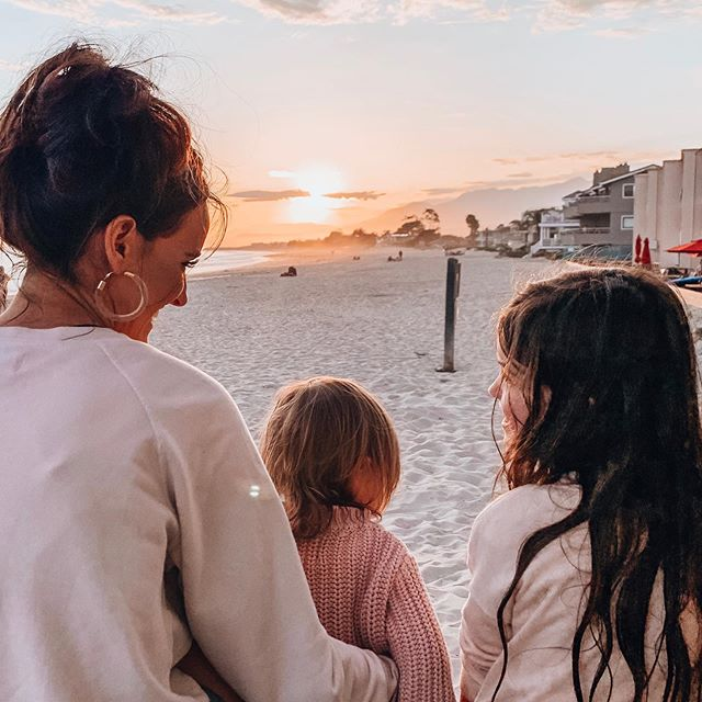 This is where you'll find us... Chasing sunsets on the beach 🌅  Cheers 🥂 to setting down our screens in the evenings 📲 and making memories with our babies! 💗 We got this mamas- nothing anyone else is doing, is better than you looking straight into their faces. No matter how long the days are.... let's soak them in.