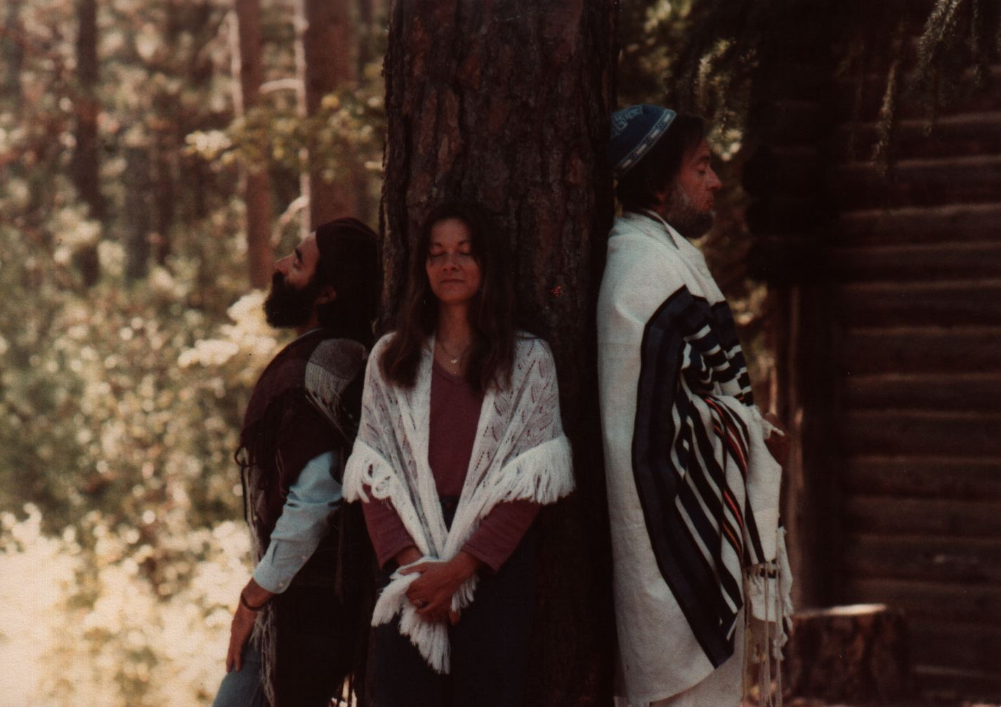 84 Joys Hanan Sills, Avraham Sand, and Windy Di Pietro davvening with backs to tree copy 2.jpg