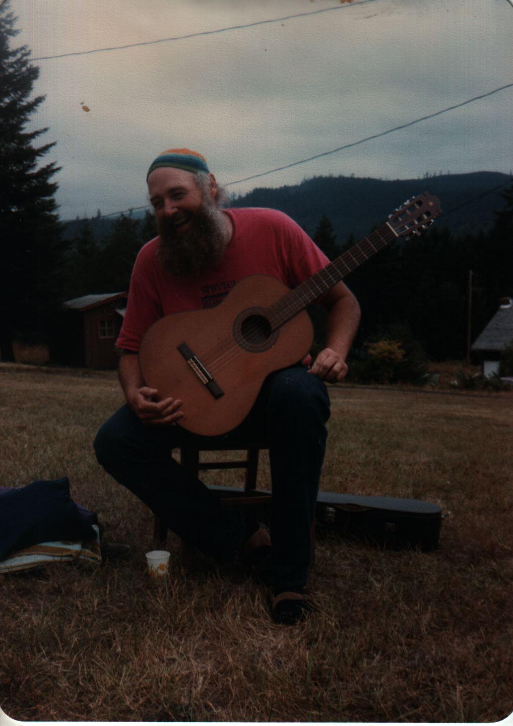 85 Joys  Keith Whithaker laughing, guitar on lap copy.jpg