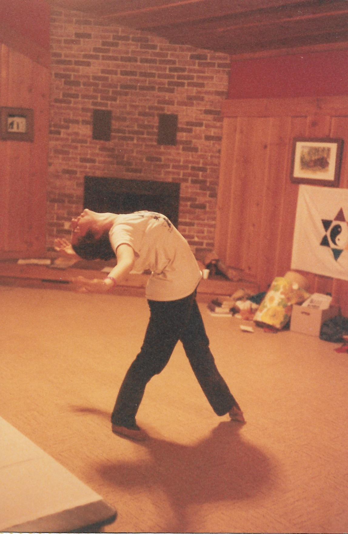 87 Joys  Maya Wallach dancing to Jeff Celnik's playing piano, Rainbow Star of David in background copy.jpeg