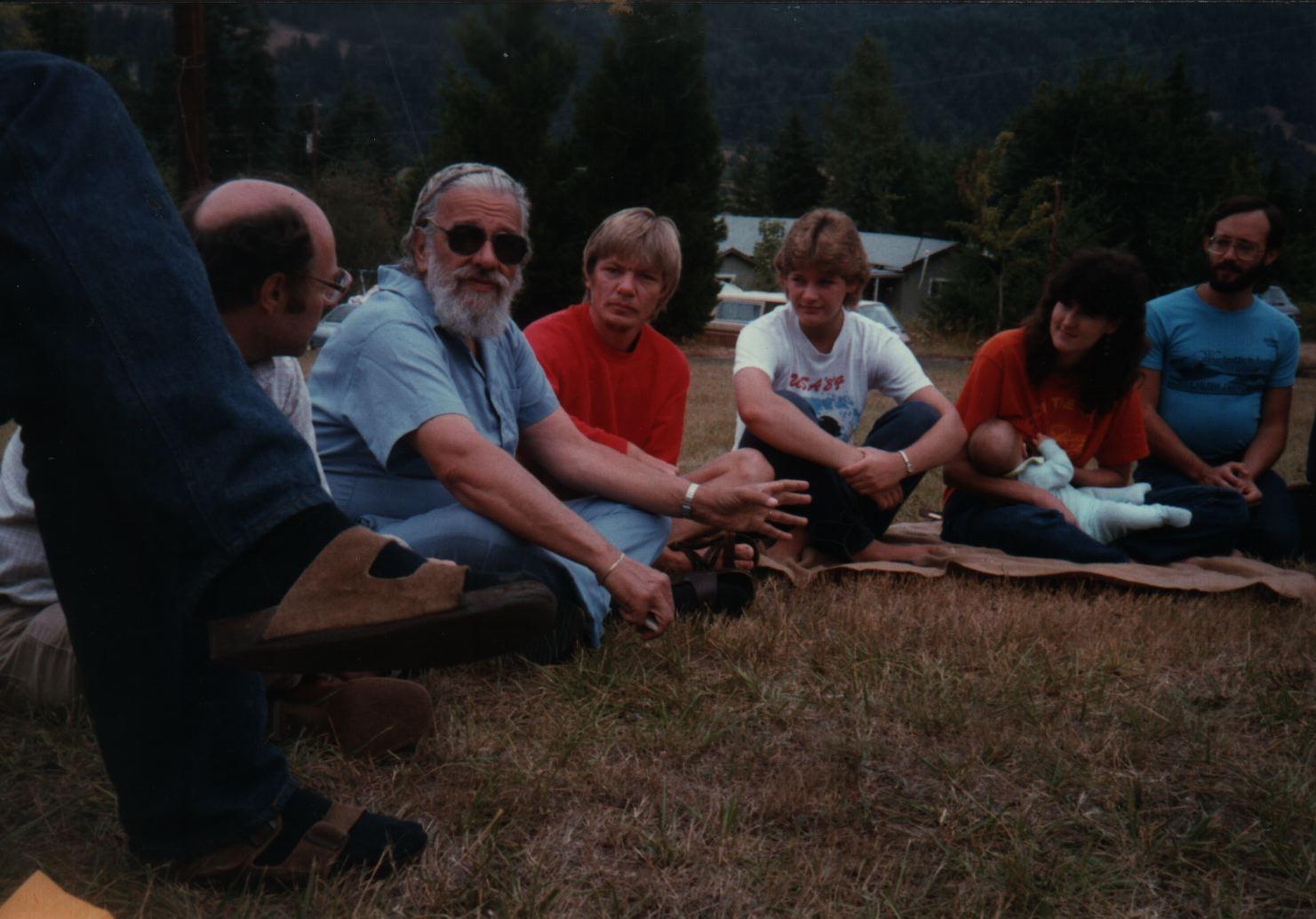 85 Joys  Zalman Schachter-Shalomi teaching, listening are Keith Whithaker (legs and sandals), Jerry Diller, Rudi Haas, ?Kathy Koroz?, Sue Henkin with baby Sasha, Malvin Finklestein copy.jpg
