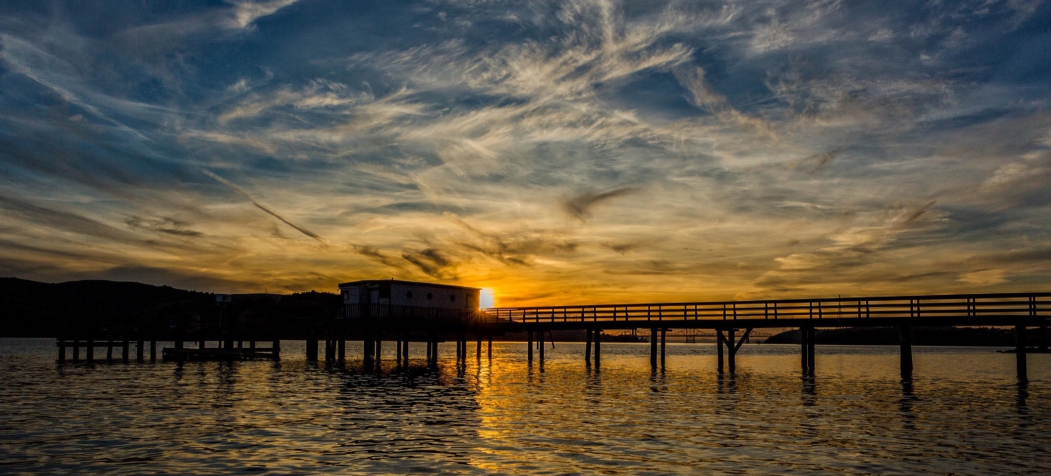 Stunning sunsets are an almost daily experience along the Carquinez Strait. Benicia waterfront, looking towards the Carquinez Bridge. Photo by Benicia resident and photographer,  Kevin Denton .