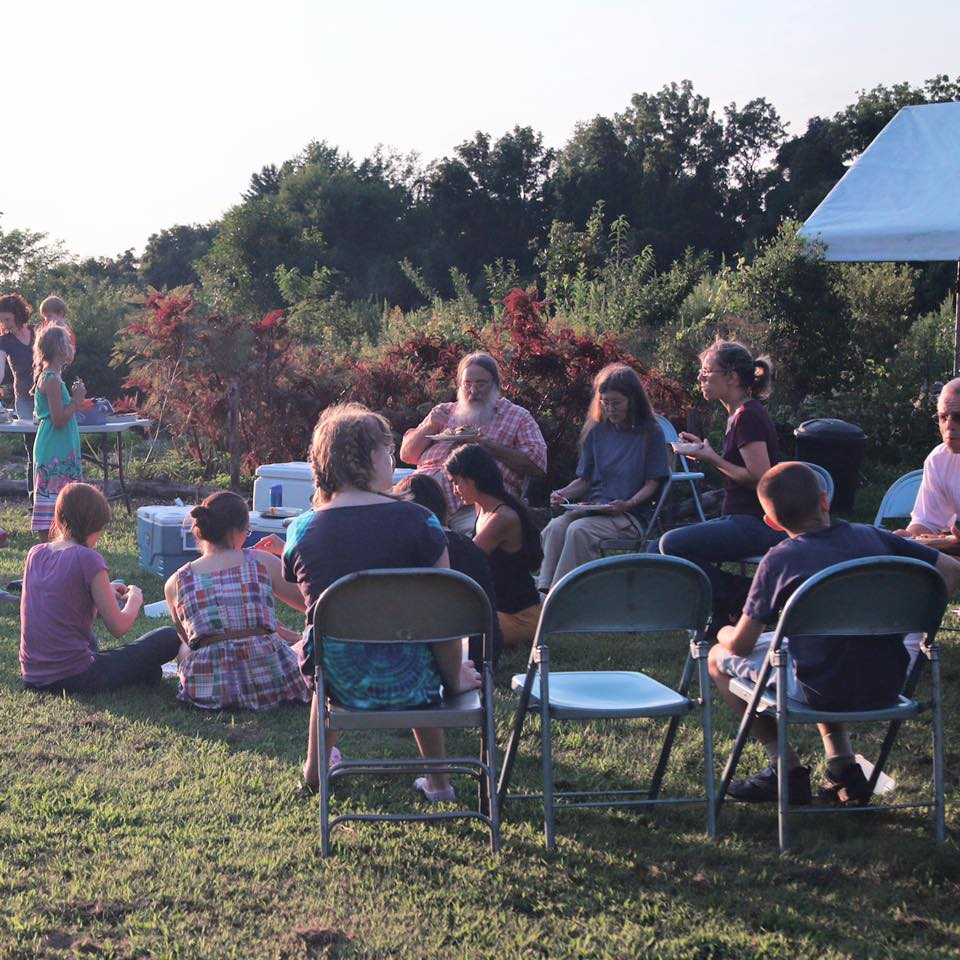 Community members gather to watch Harvests of Hope and discuss food and sustainability