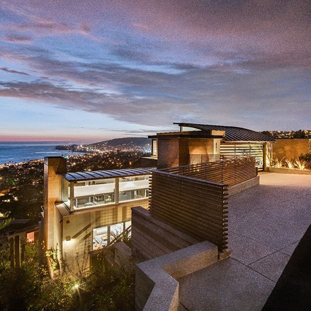 Nestled in the rolling hills of Laguna, this spectacular, custom 3-story home captures the views of Catalina and the coastline during the day and twinkling lights of Laguna Beach by night! #grahamarchitecture #lagunabeach #contempory #modernarchitecturedesign #customhomes