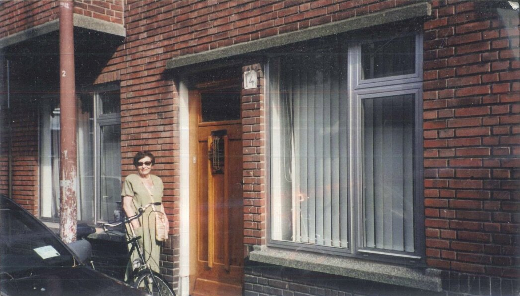 Dorrit in front of 14 Pieter van den Zandestraat, the streetside flat where she and her family spent 1036 days in hiding, as recounted in  The Frank Family That Survived .
