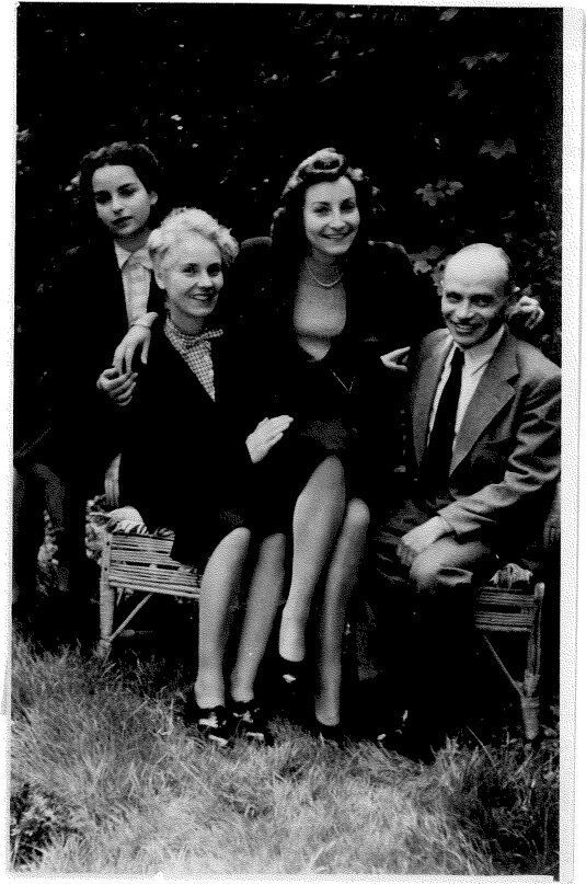 "Jubilation: Dorrit, with Sybil, Flory and Myrtil, in the photo of the family that Til had made to send to their relatives around the world to confirm that, fears and rumors to the contrary, the four Franks had indeed survived the war, the Occupation, and their thousand days in hiding. The caption on the reverse of the photo, which Til had made into a post card, simply said: ""After the Liberation. Summer, 1945."""