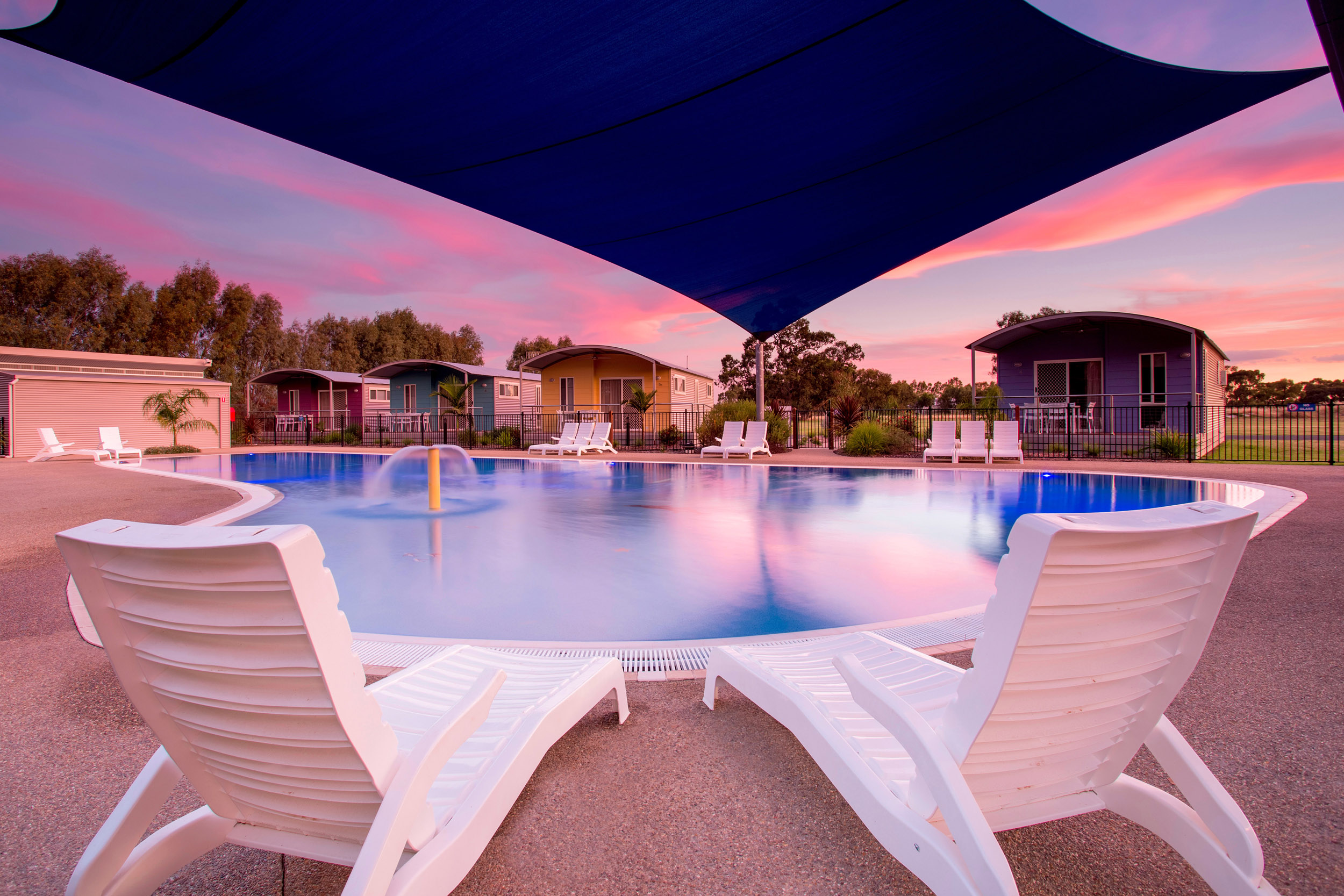 poolside-at-dusk-holiday-park-resort-photography.jpg