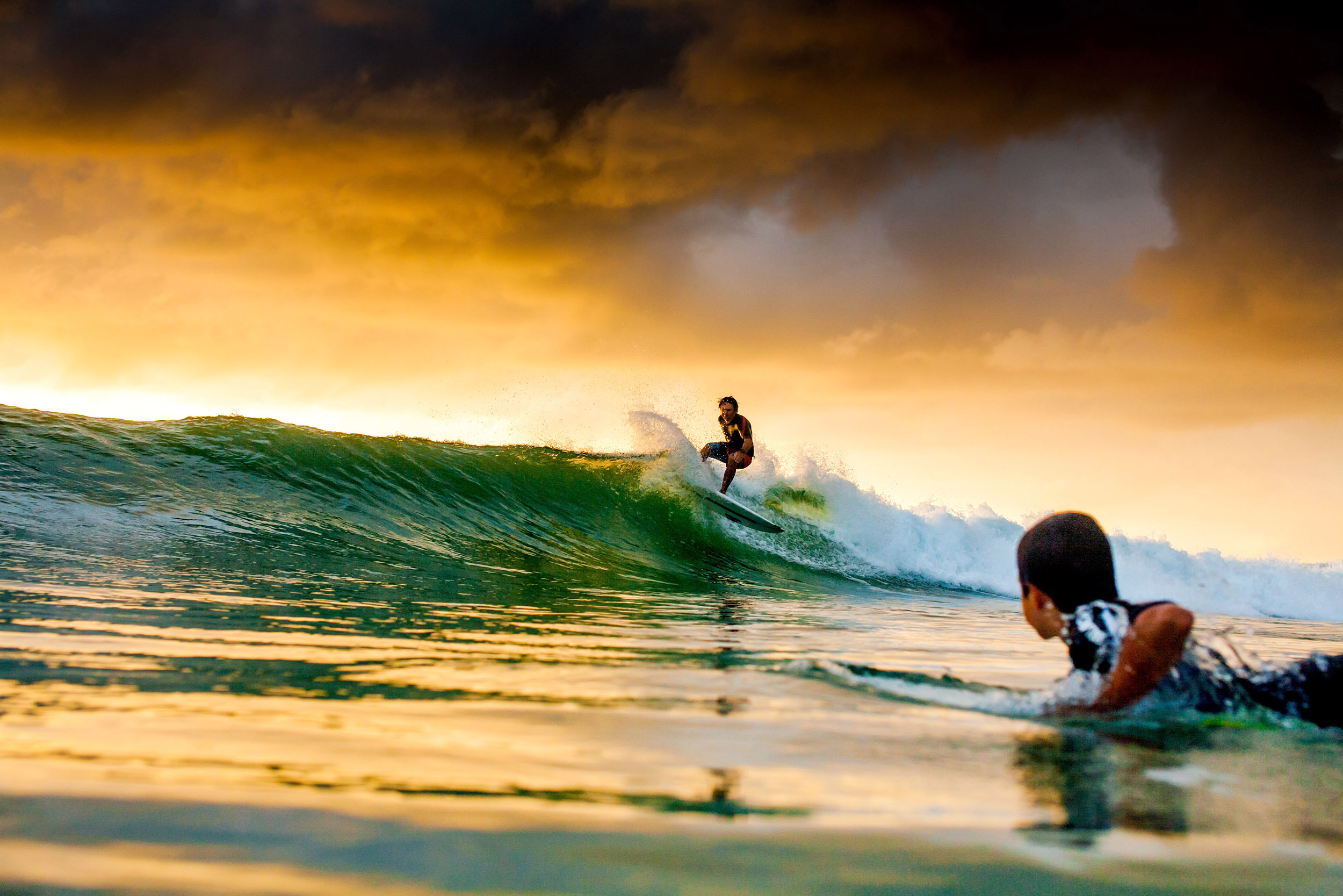 father-and-son-surfing-sunrise-S1289-377.jpg