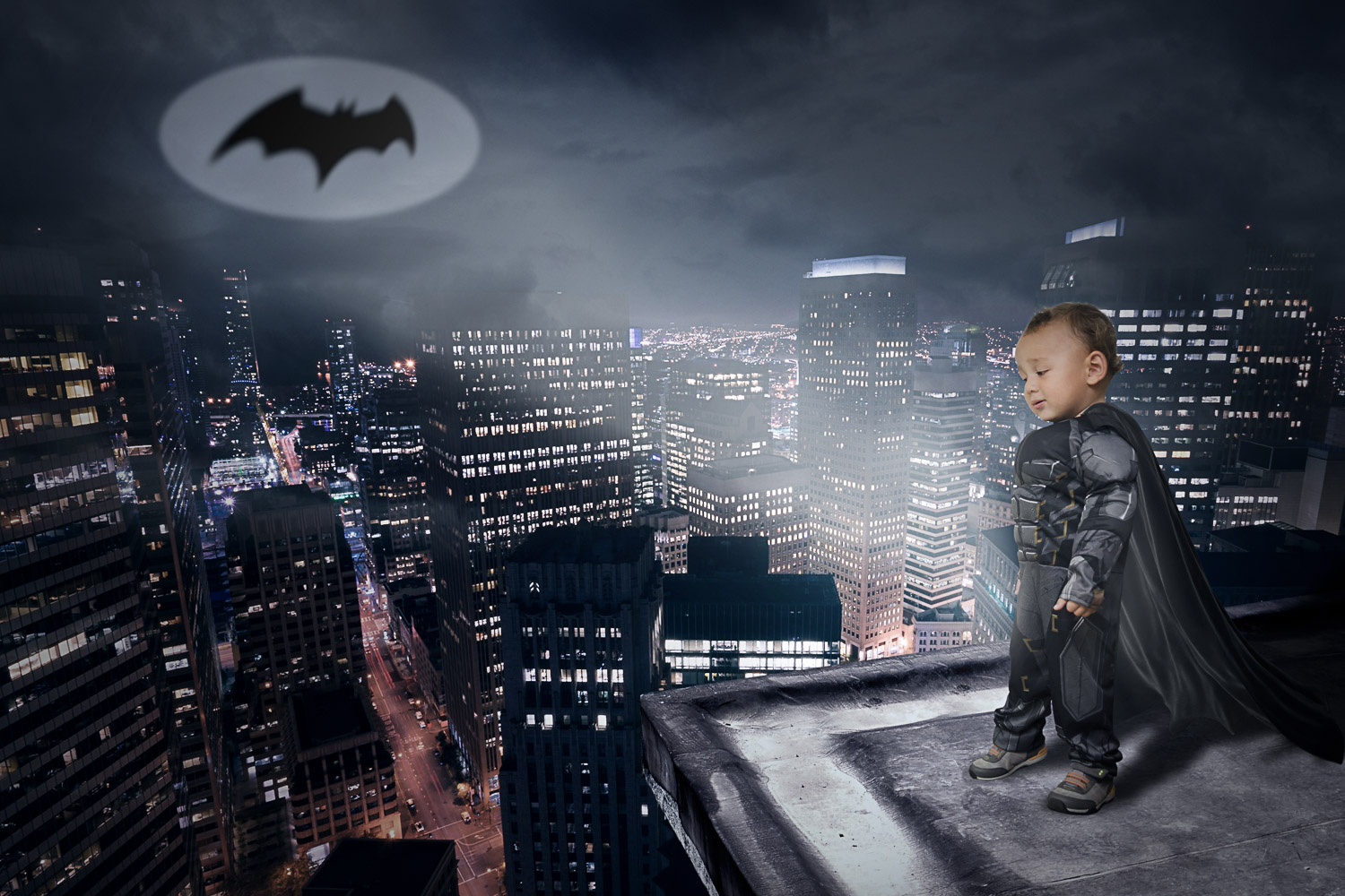 little boy batman over cityscape storybook composite