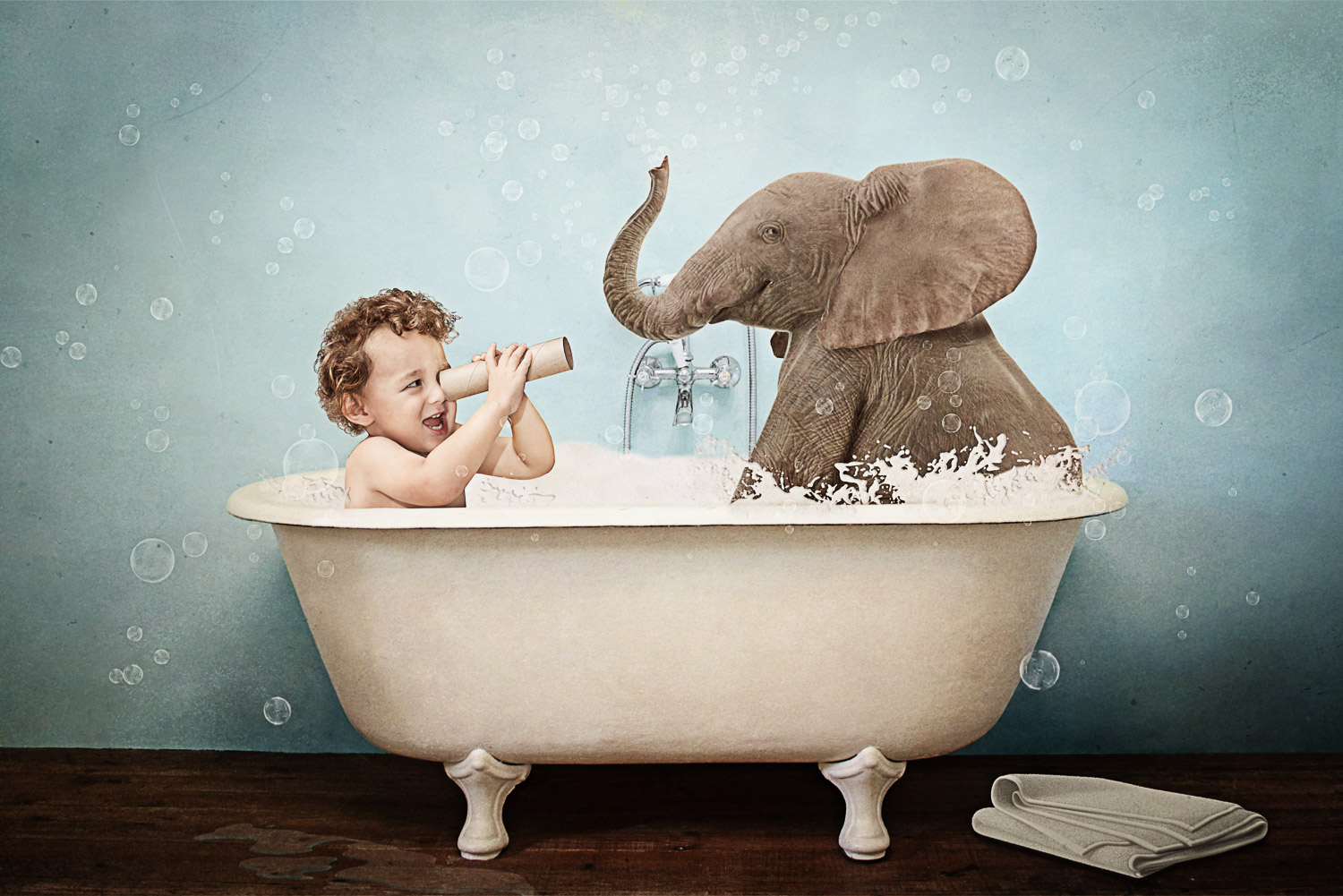 little boy in bathtub with an elephant storybook composite