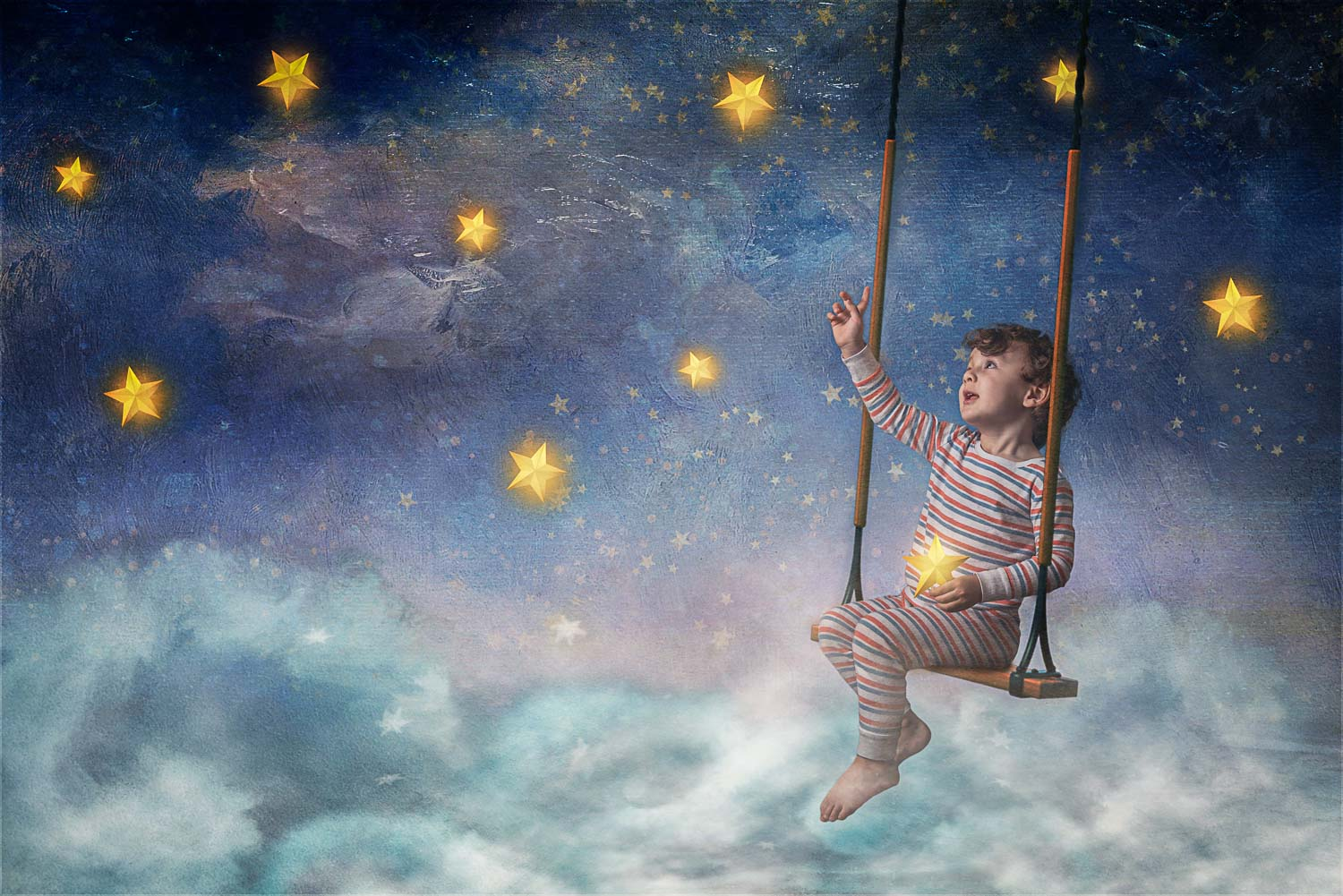 little boy on swing picking stars above the clouds storybook composite