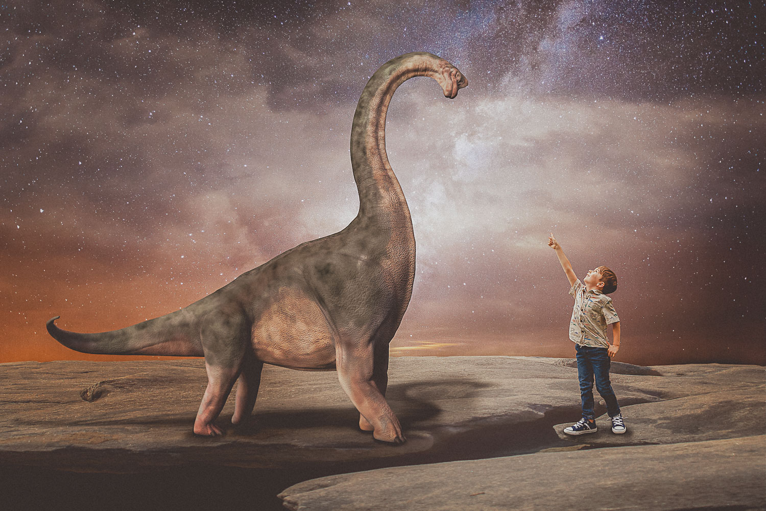 little boy pointing to brachiosaurus dinosaur underneath the stars storybook composite