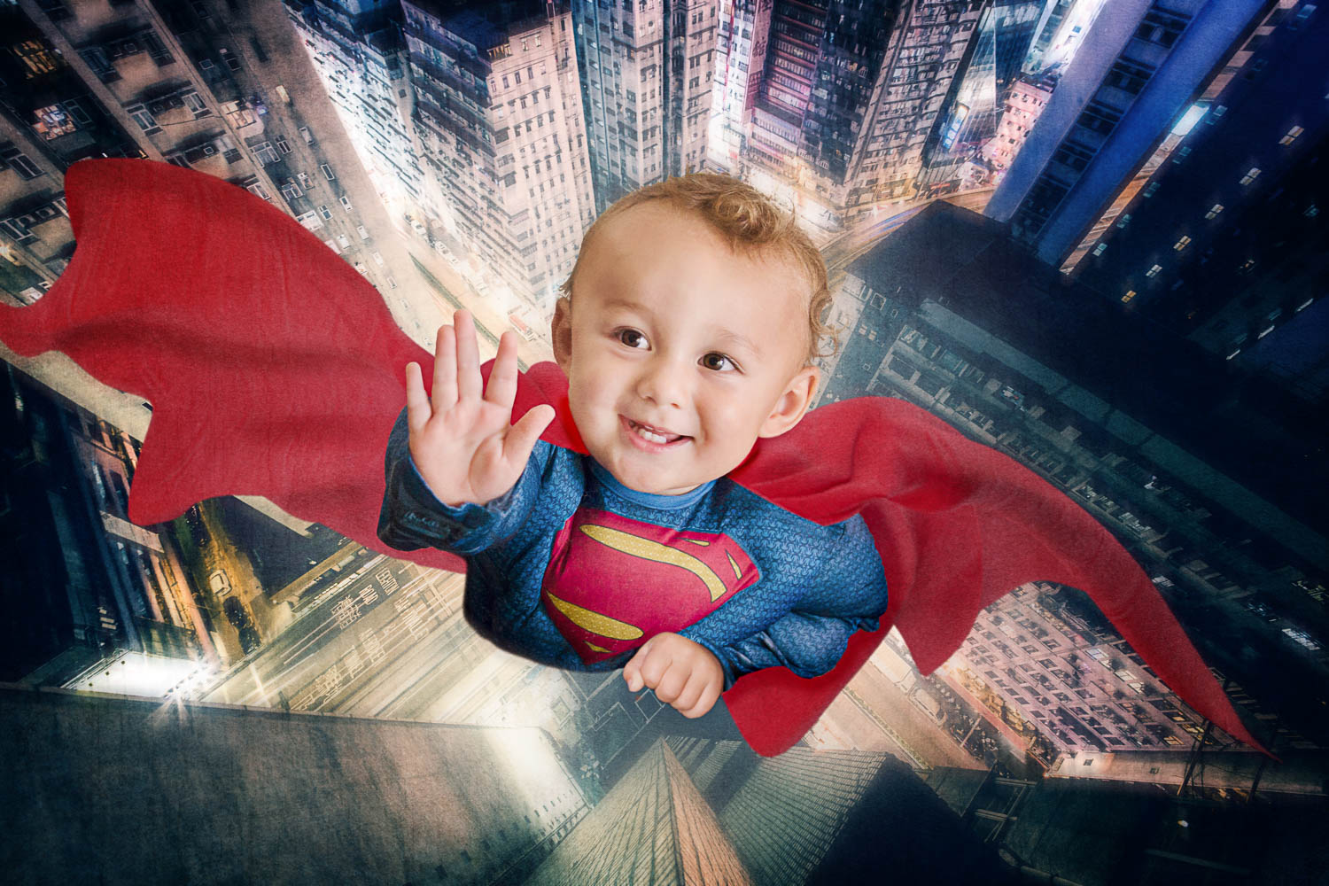 Little boy superman flying through city storybook composite