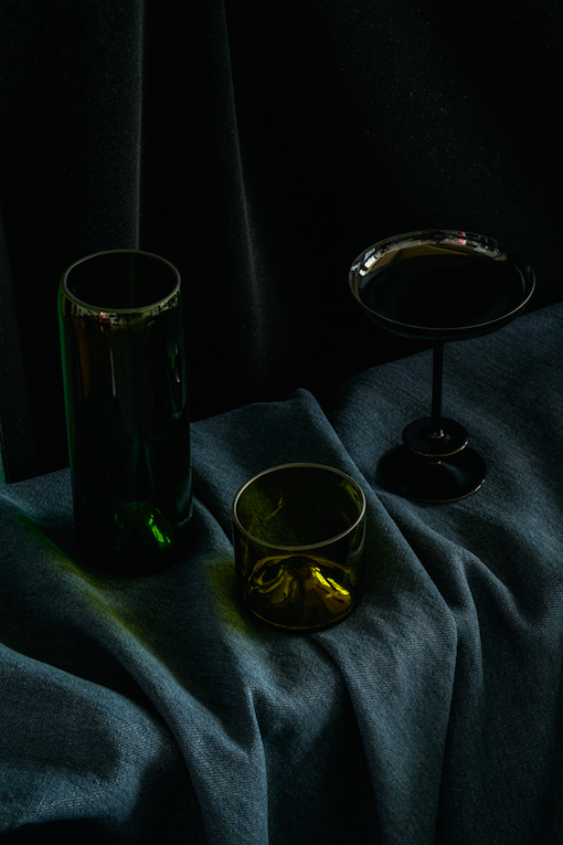 Image credit: Aria Recycled Vase and Wine Glass with LSA Truffle Coupe. Velvet and linen, Pierre Frey. Photography: Alexander Edwards.