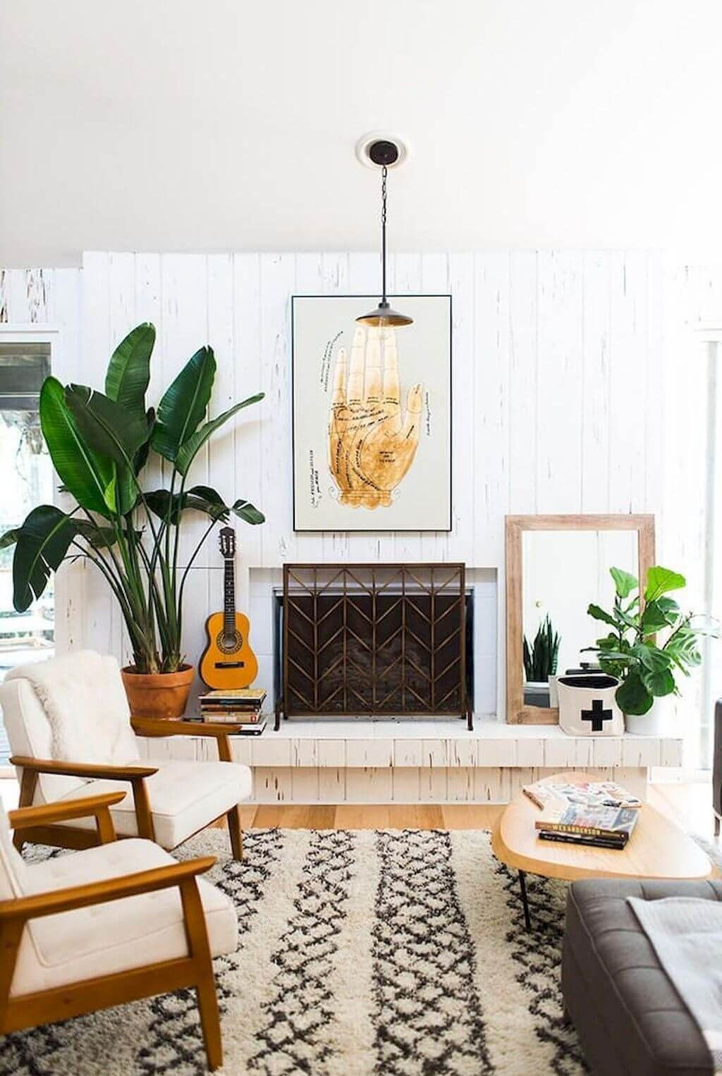 interior-design-chic-bohemian-living-room-with-contemporary-geometry-black-and-white-rug-including-cream-upholstery-wooden-armchair-plus-catchy-sleek-paneled-wall-themed-decor.jpg