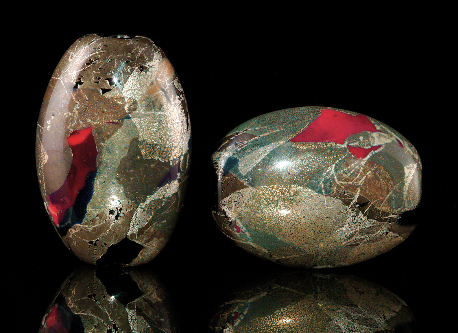 """""""Red Bronze Beads"""", oval lenticular shapes with silver and gold colorants, about 3 cm. 2001."""