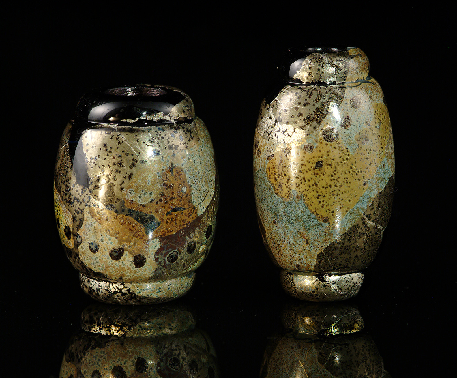 """""""Nebula Black Vessel Beads"""", with silver and gold colorants, tallest bead about 3 cm. 2000-2001."""
