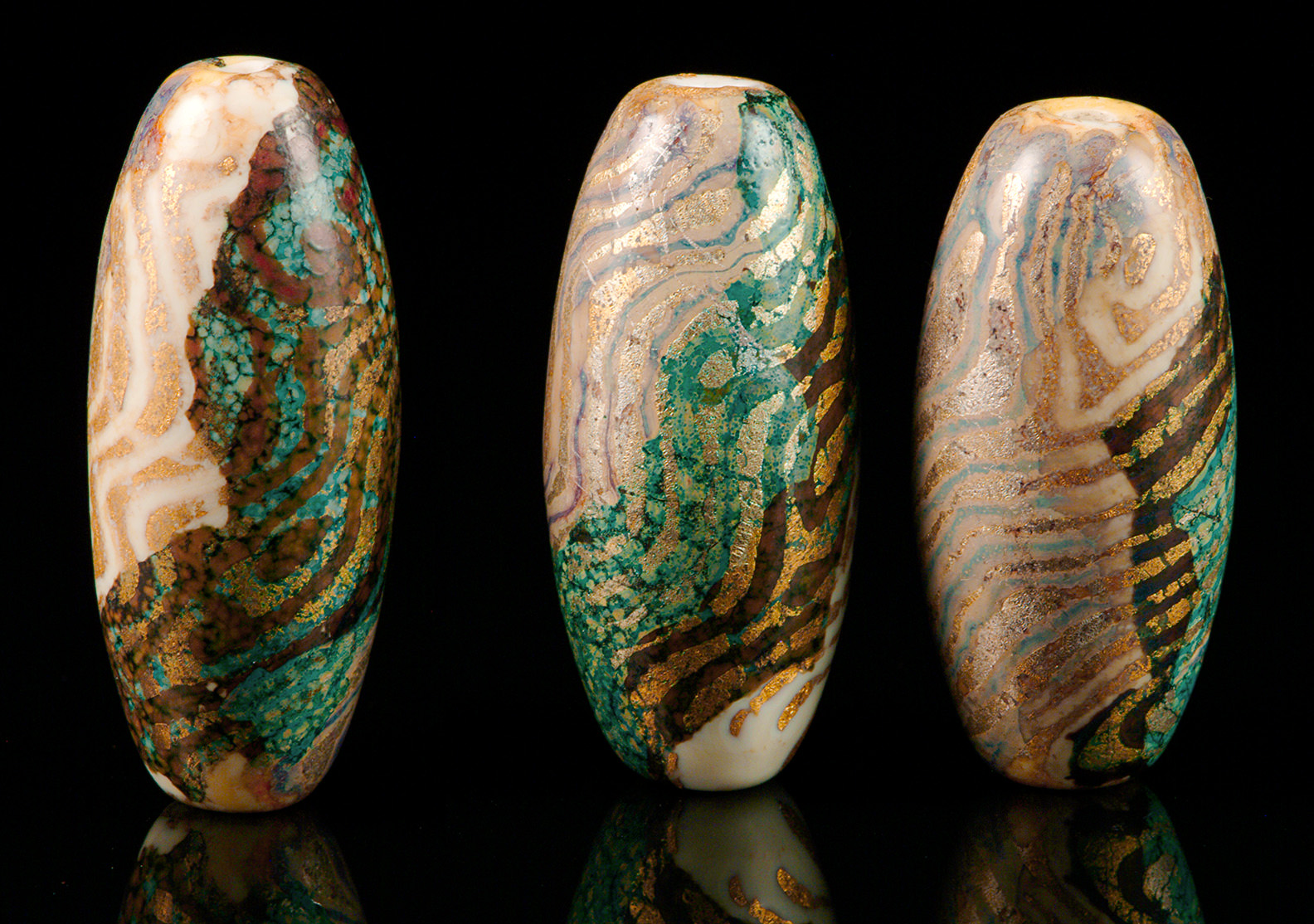 """Aerial View Beads"", colored with copper, silver and gold, tallest about 4 cm"