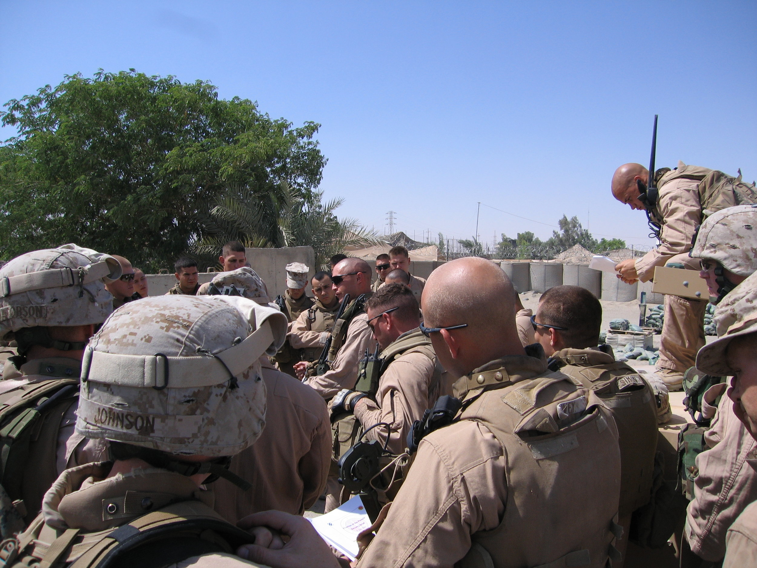 Captain Cullins briefs the steely-eyed killers of Weapons Company, 3rd Battalion, 7th Marines before a mission. (Ramadi, Iraq)