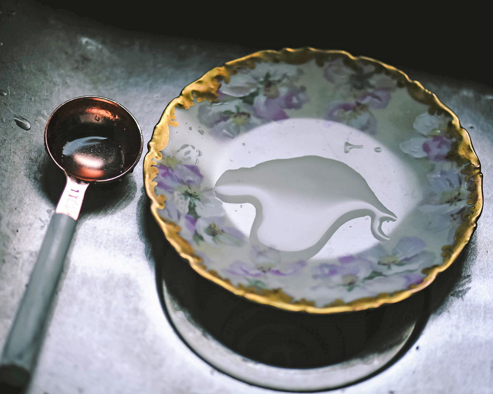 measuring spoon and plate in sink
