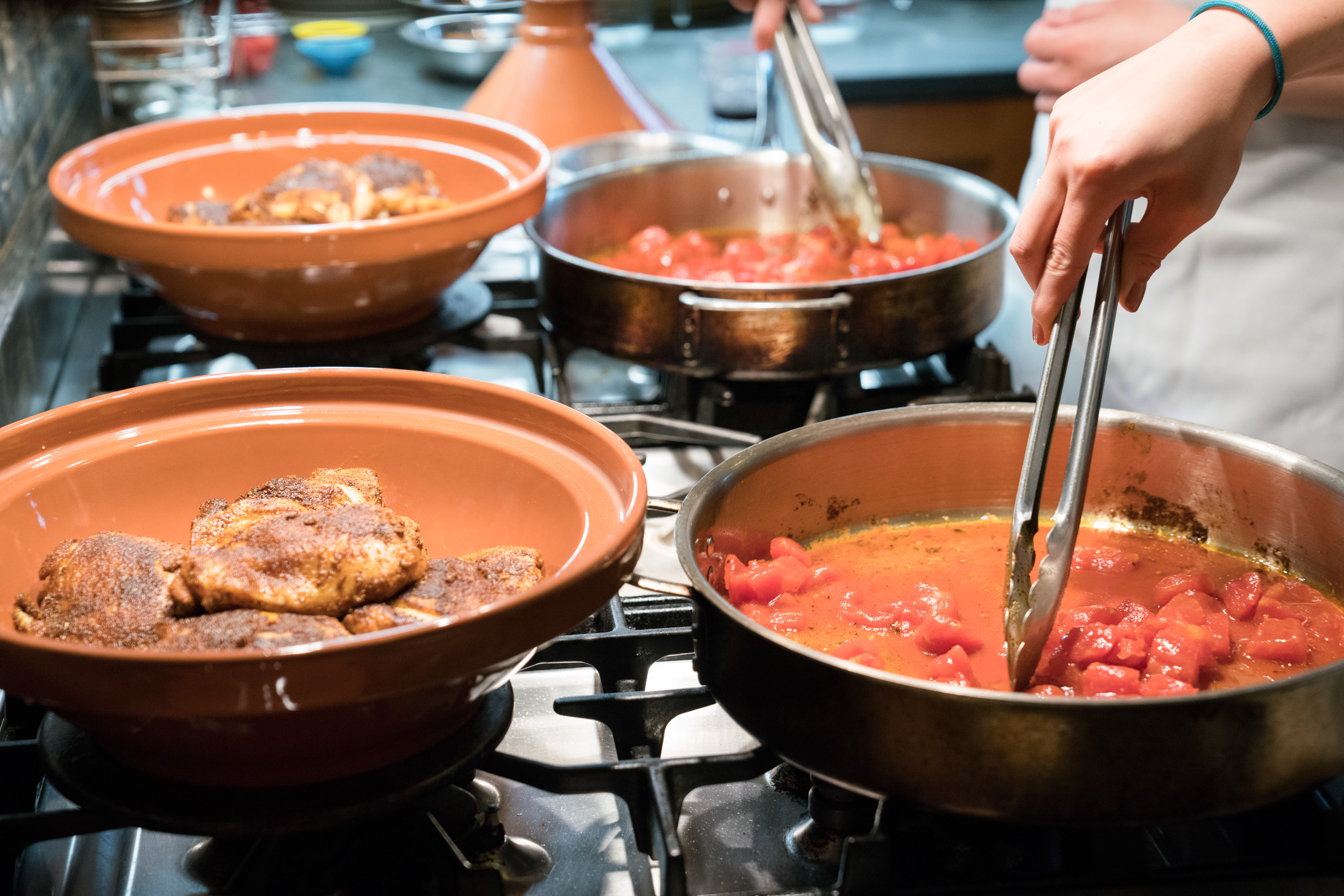 Cook-with-Chef-Traci-Team-Building-Cooking-tomatoes-for-tagine.jpg
