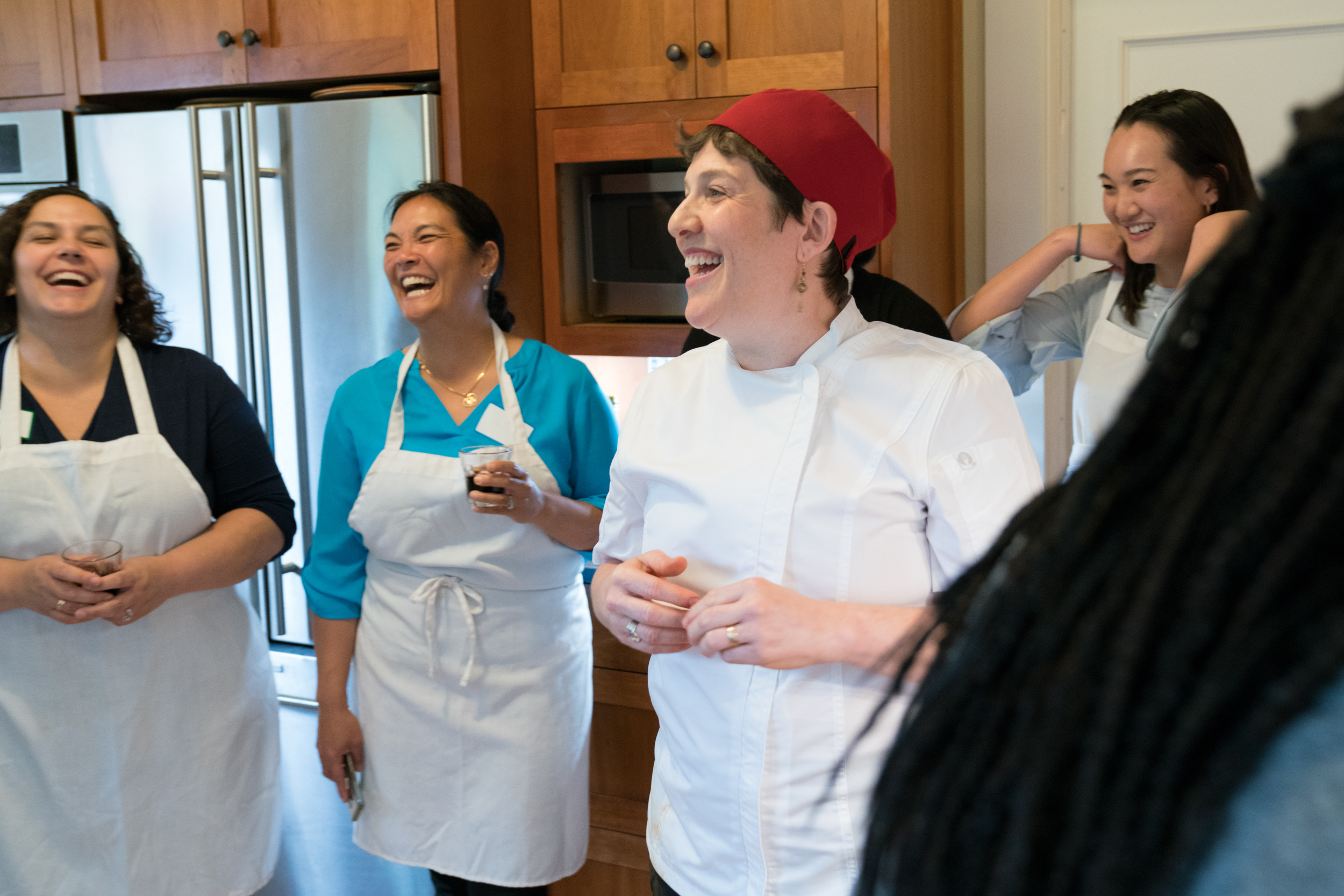 Cook-with-Chef-Traci-team-building-laughing-with-team.jpg
