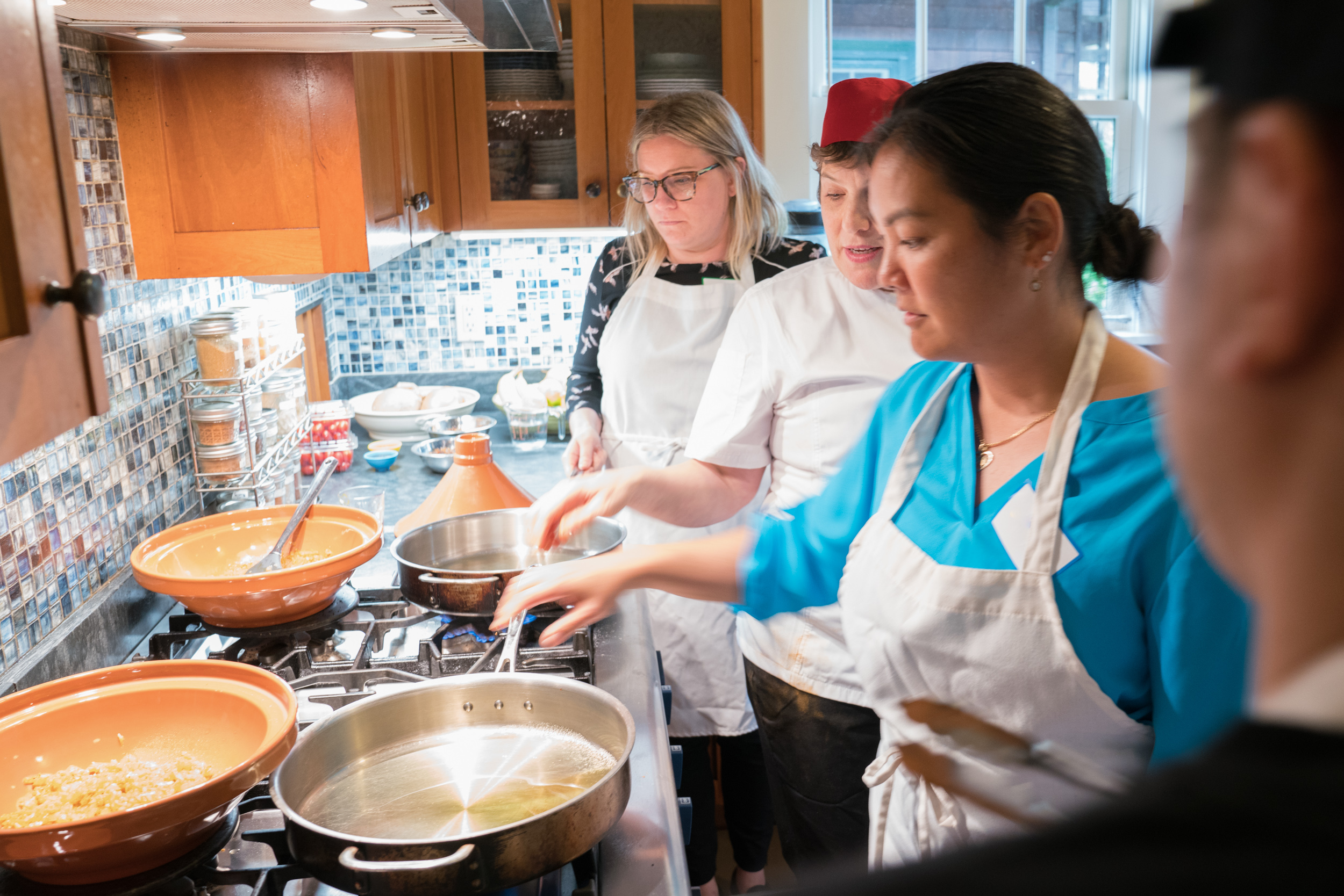 Cook-with-Chef-Traci-team-building-heating-oil-for-making-tagine.jpg