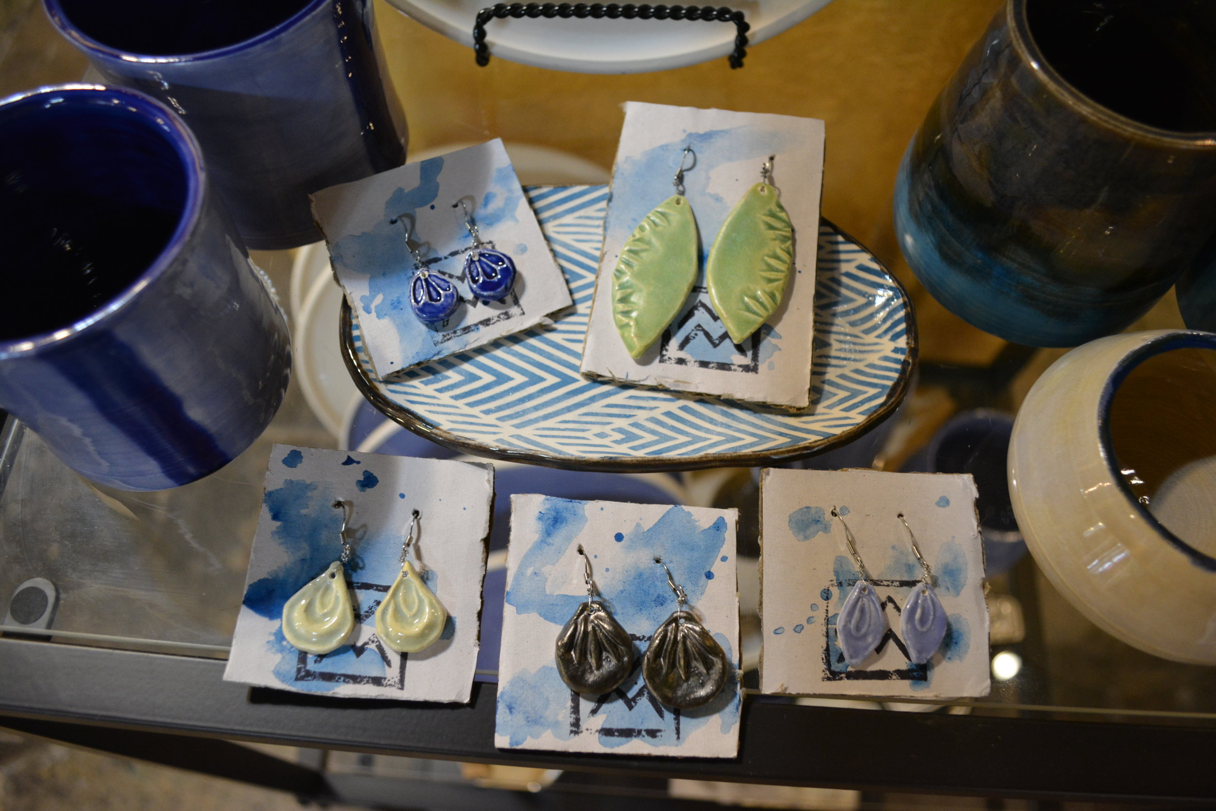 Morgan Mattson - Hand-built ceramic earrings with calming plant accents.