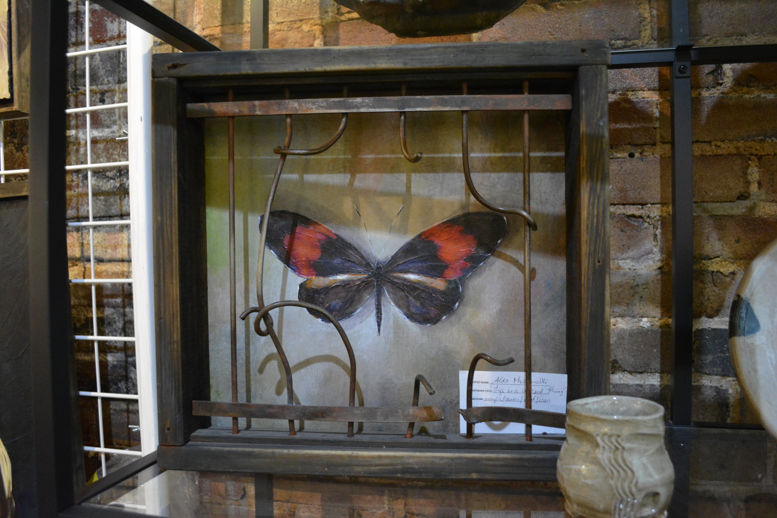 Aldo Muzzarelli - Acrylic, Canvas, Wood and Iron. Butterfly paintings in handmade frames some made with hand-made  iron rods presenting a gate/cage for the butterfly.