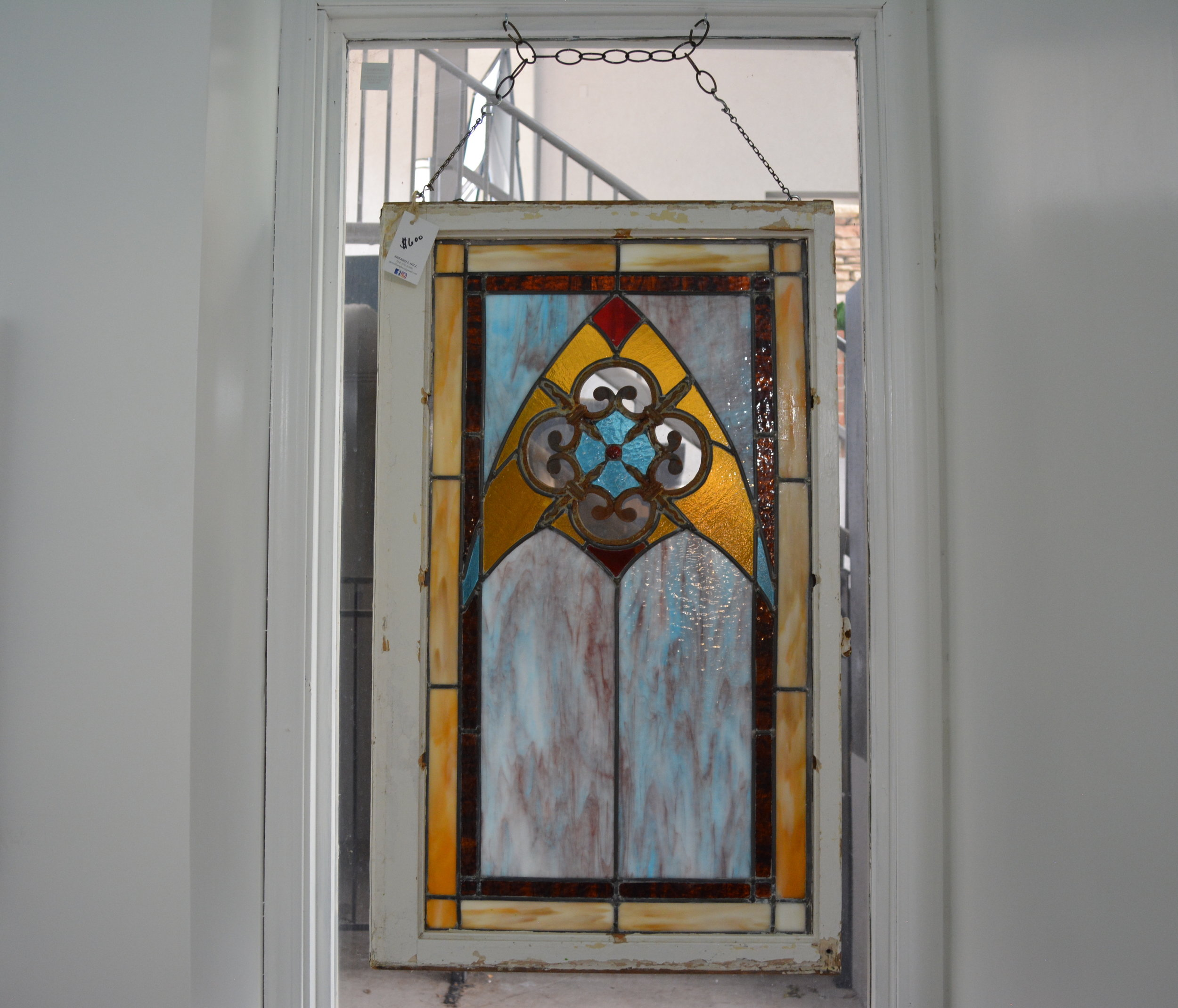 Sherrill Hill - Stained glass artist creating work to hang on your window as well as custom work in windows. Often incorporating antique found materials.