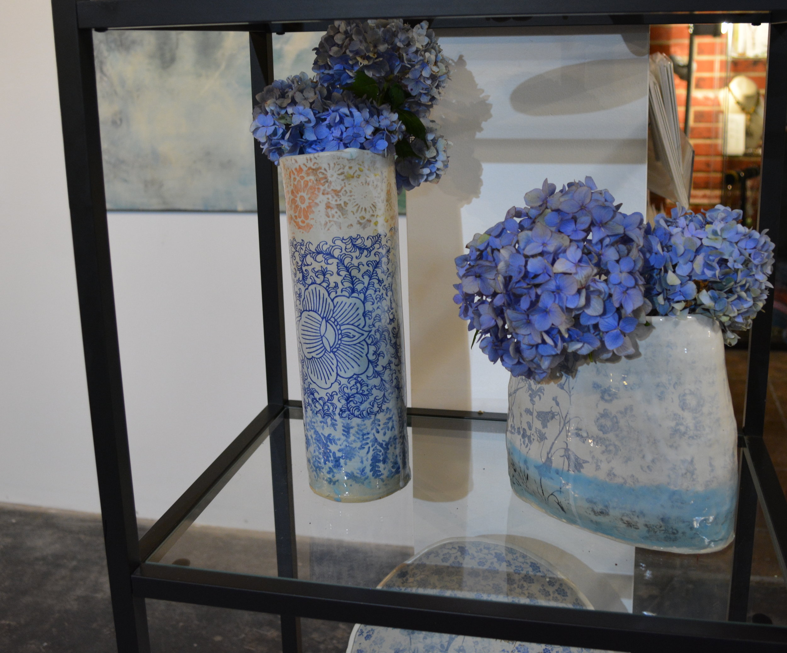 Lindsay Lousie McPhail - Slab built functional ceramic work often featuring floral patterns throughout in blue, white and red.. Vases, dishes, ornaments, mugs, and wall hangings,