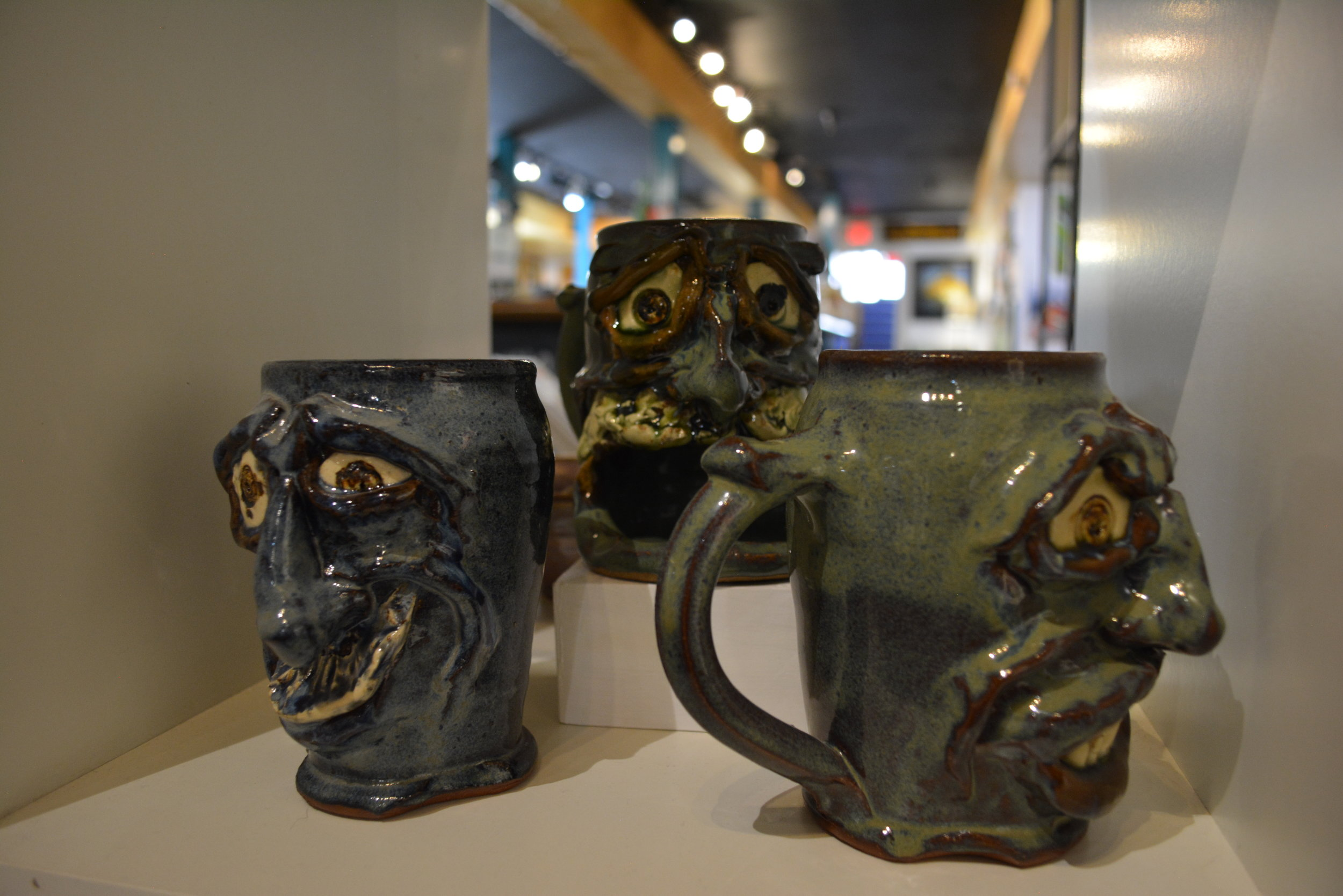 Kate Krauss - Most known for her sculpted face mugs in metal like colors made in ceramic. As well as South Carolina crest mugs, cat bowls and cookie jars.