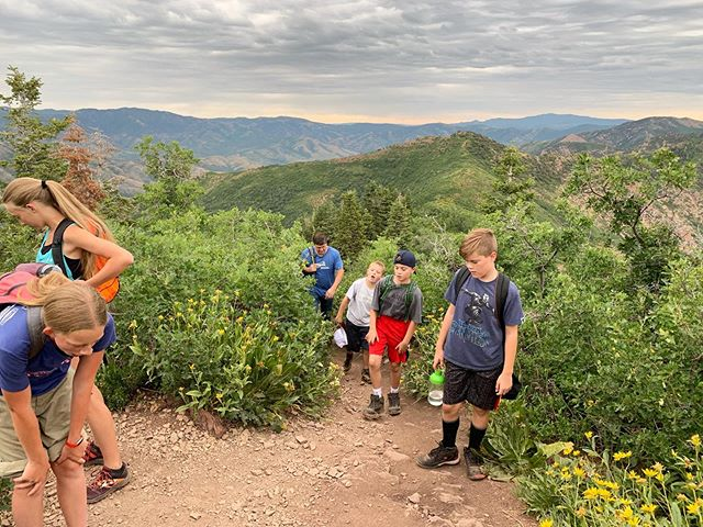 """Pictured here is one of the many moments of doubt, of wondering what they all signed up for (6.5 miles and 2,600 feet of elevation gain to be exact) and potentially one of the points of questioning """"are we there yet?"""" as mentioned in the previous post, as we worked our way up Grandeur Peak this morning!"""