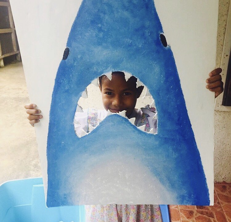 Kindergarden student learning about shark conservation in what was once a shark finning village, Fiji