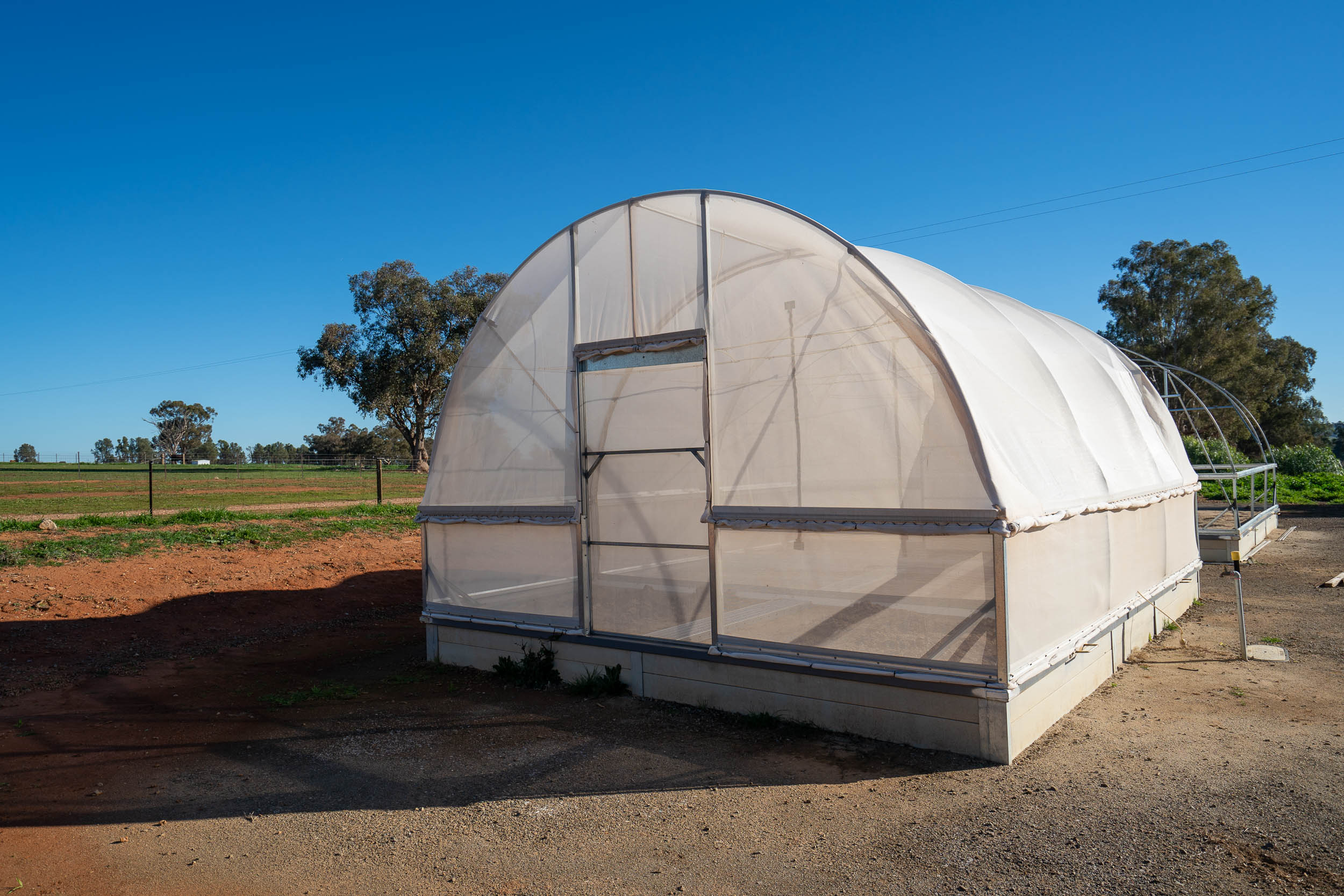 The hoop house for outdoor rearing of dung beetles.
