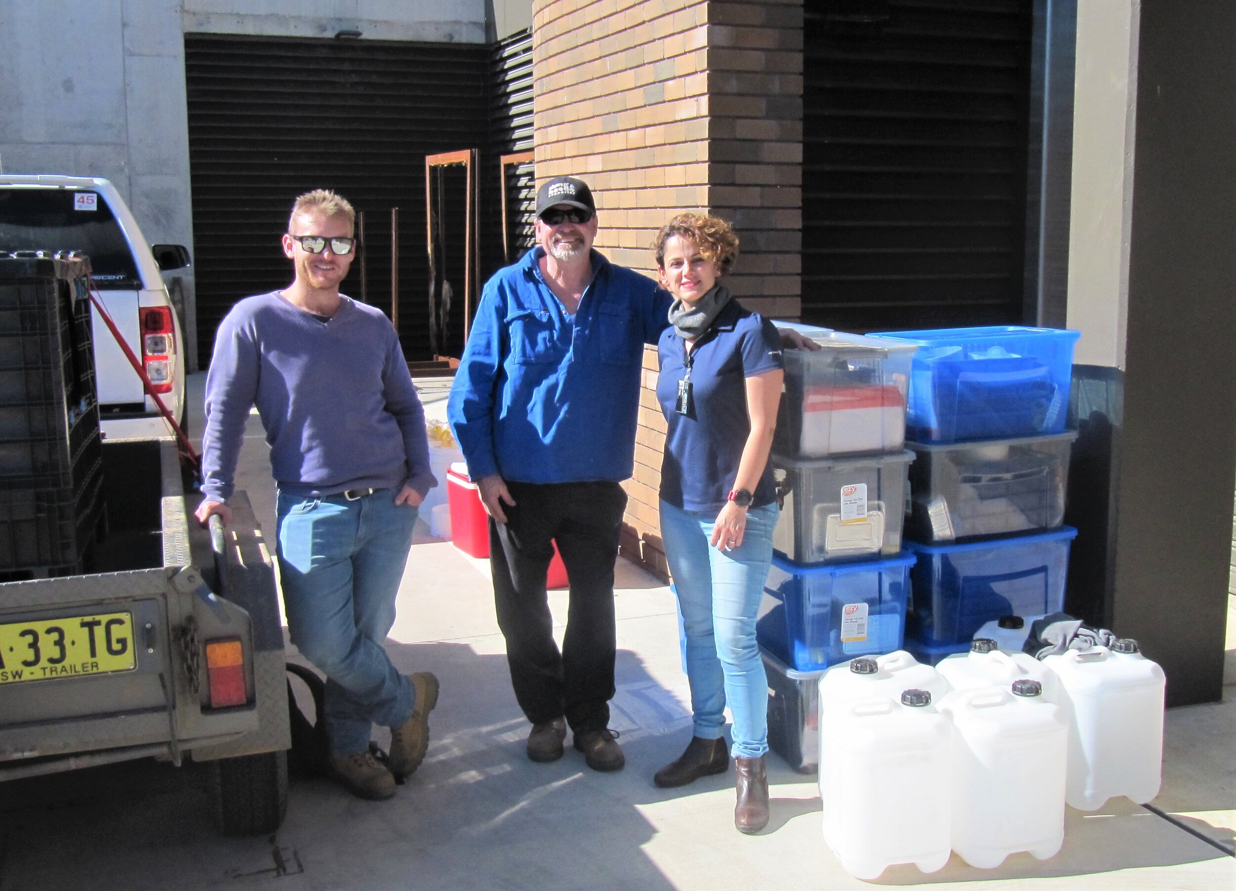 Zac Hemmings, Graeme Heath and Behnaz Ghaedi at UNE taking delivery of the dung beetle field monitoring kits