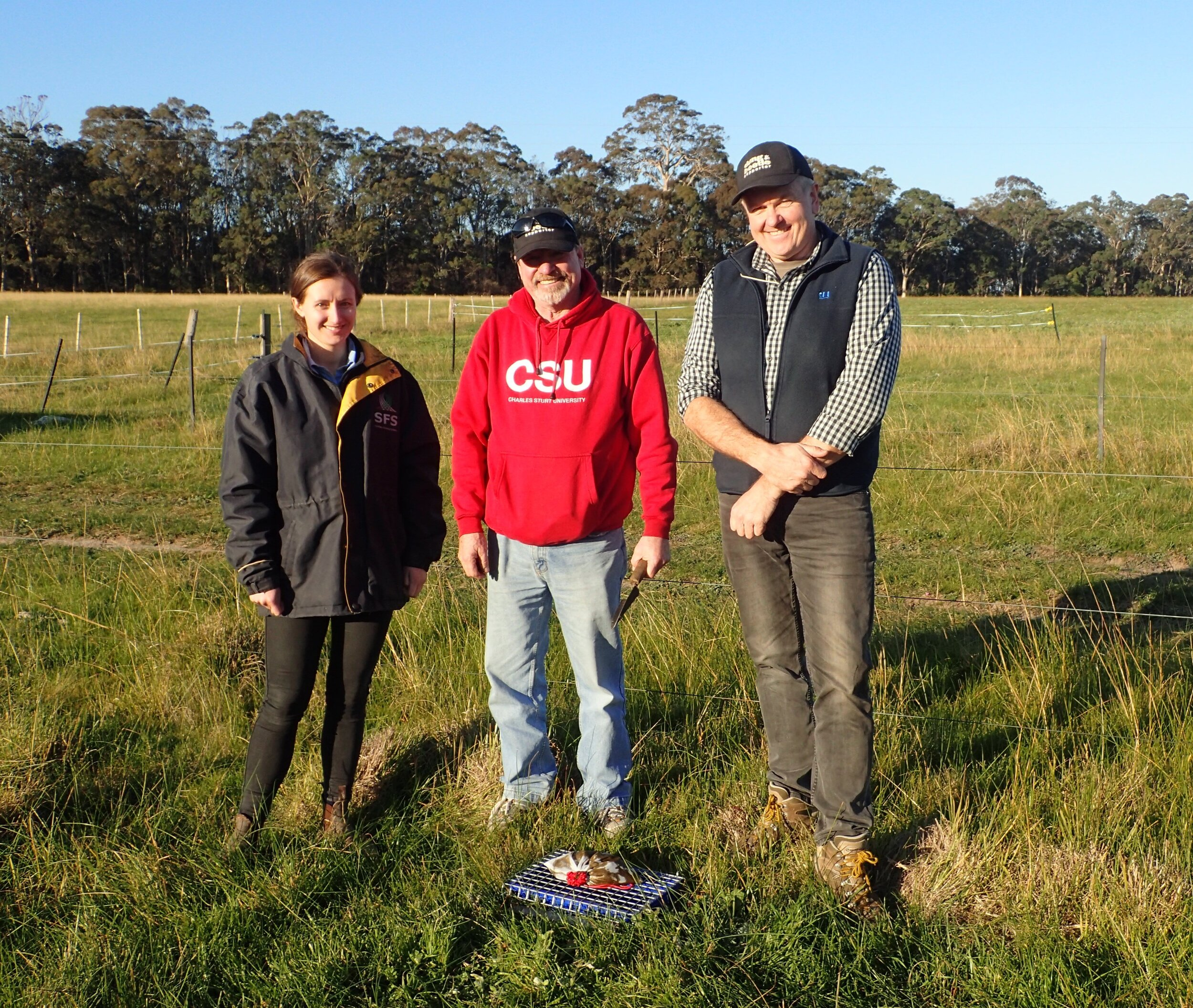 Ashley Amourgis, Graeme Heath and Russ Barrow with a dung beetle pitfall trap.
