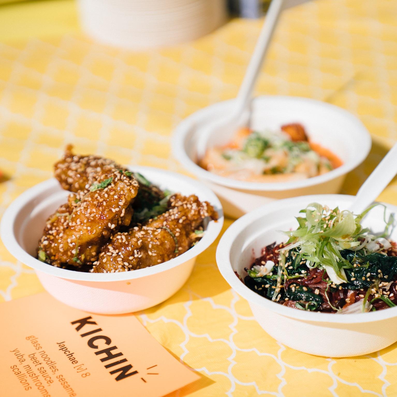 Kichin's spicy wings, ddukkbokki, and beet japchae. Photo by Janice Chung for HFNM 2019.