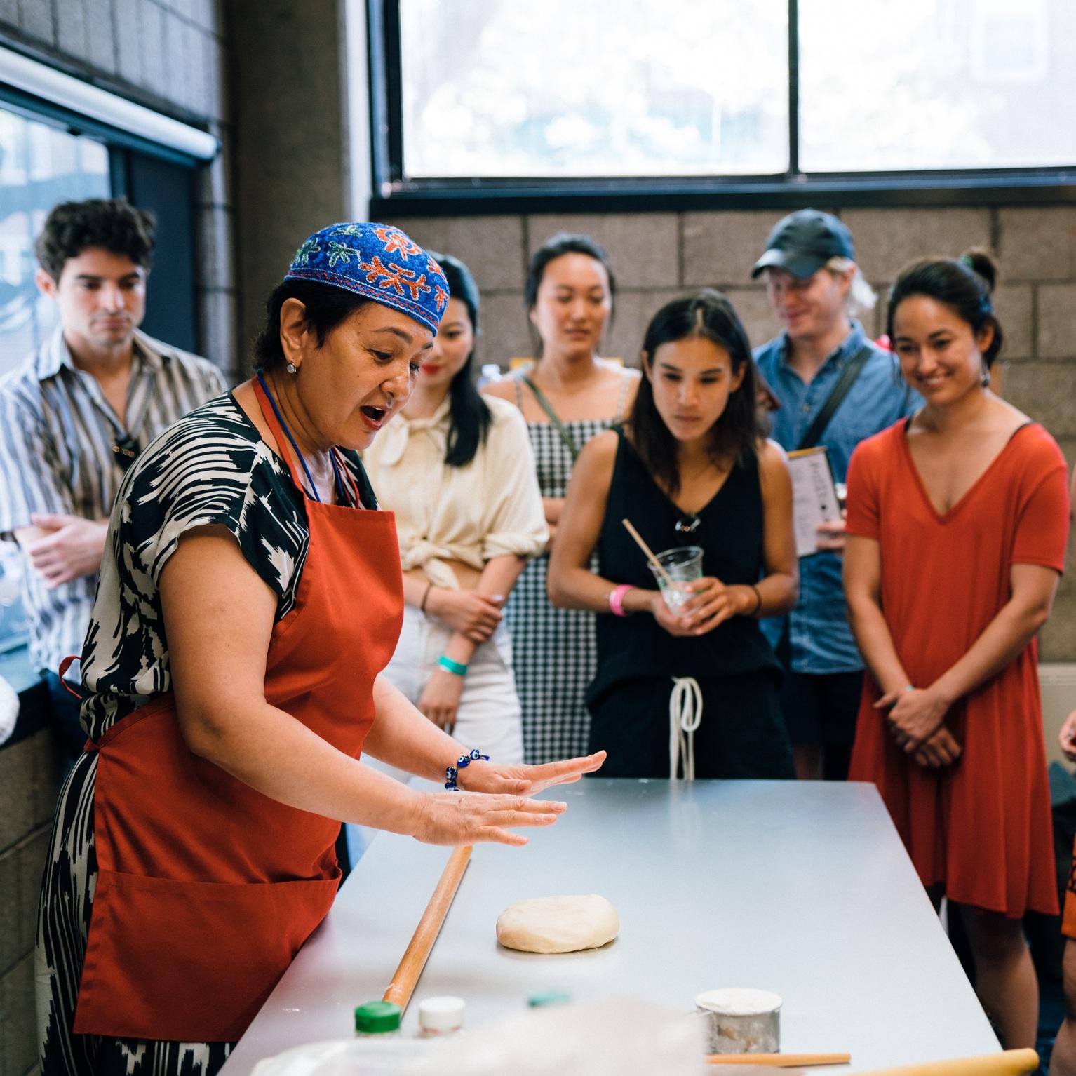 Damira rolling out sambusa dough. Photo by Janice Chung by HFNM 2019.