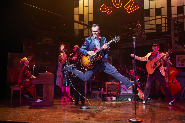 MILLION DOLLAR QUARTET (2012-2019) - As of May 26, 2019 I have performed the role of Carl Perkins (father of rockabilly) 726 times. I owe much of this extraordinary employment to original MDQ music director, Chuck Mead- a great musician, writer, teacher, and friend.Production history:Berkshire Theatre Group (Director/Music Director, 2017 Berkshire Theatre Critics Association Award, Best Direction of a Musical)Performance credits: 1st Nat'l Tour (Carl Perkins, Directed by Eric Shaeffer), Gateway Playhouse/Ogunquit/Paper Mill Playhouse/Fulton Theatre/Maine State Music Theatre/Cape Playhouse/Great Lakes Theatre (Carl Perkins & Music Director, Directed by Hunter Foster), Riverside Theatre (Carl Perkins & Music Director, Directed by Keith Andrews) The New Theatre (Carl Perkins, Directed by Joe Fox), Arrow Rock Lyceum (Carl Perkins, directed by David Hemsley Caldwell).MDQ VIDEOS: Maine State Music Theatre, Paper Mill Playhouse, Ogunquit, Hard Rock Cafe Memphis, Radio Performance with Scott Moreau