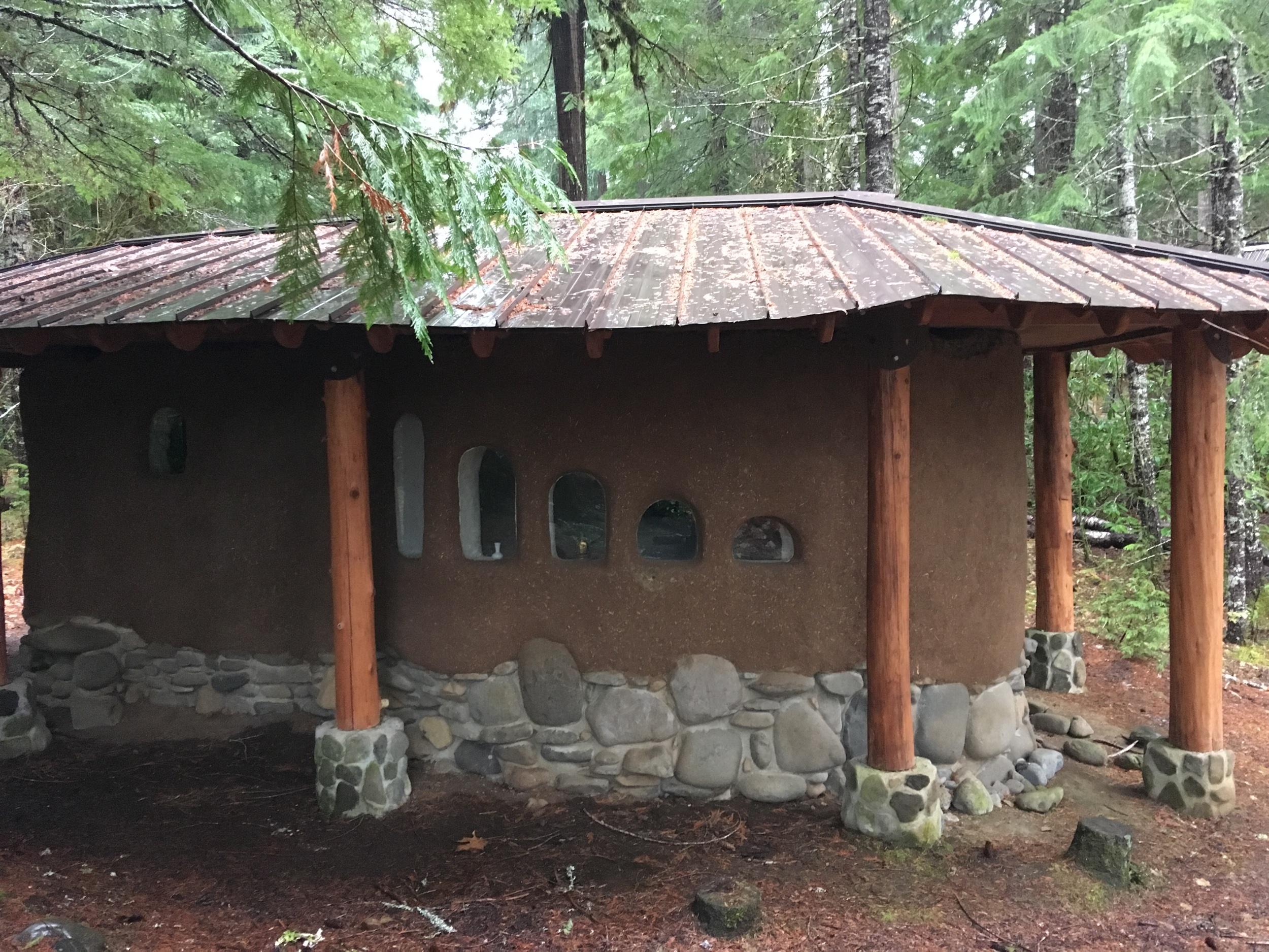 Cob Meditation sanctuary. Sunrise windows. Finished roof, finished plaster.