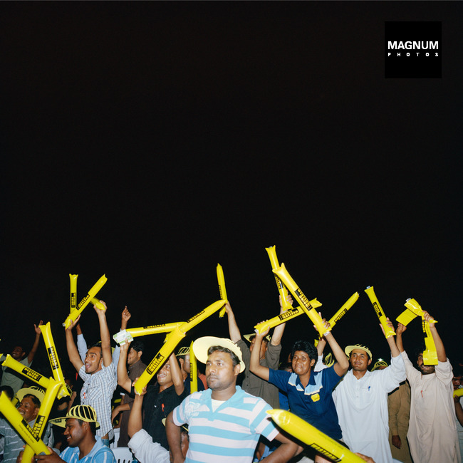 U.A.E. Dubai. 'Champ ka Camp' singing competition in the labour camp. 2013    ©Olivia Arthur / Magnum Photos