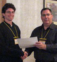Michael Aberle receiving his  R.S.T. certificate from  SCST President Gil Waibel