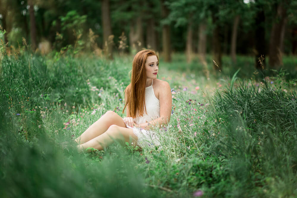 sioux-city-senior-photography-white-dress-flowers-in-woods-suing-studios.jpg