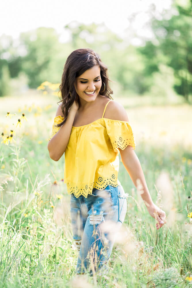 sioux-city-senior-photography-yellow-flowers-field-suing-studios.jpg