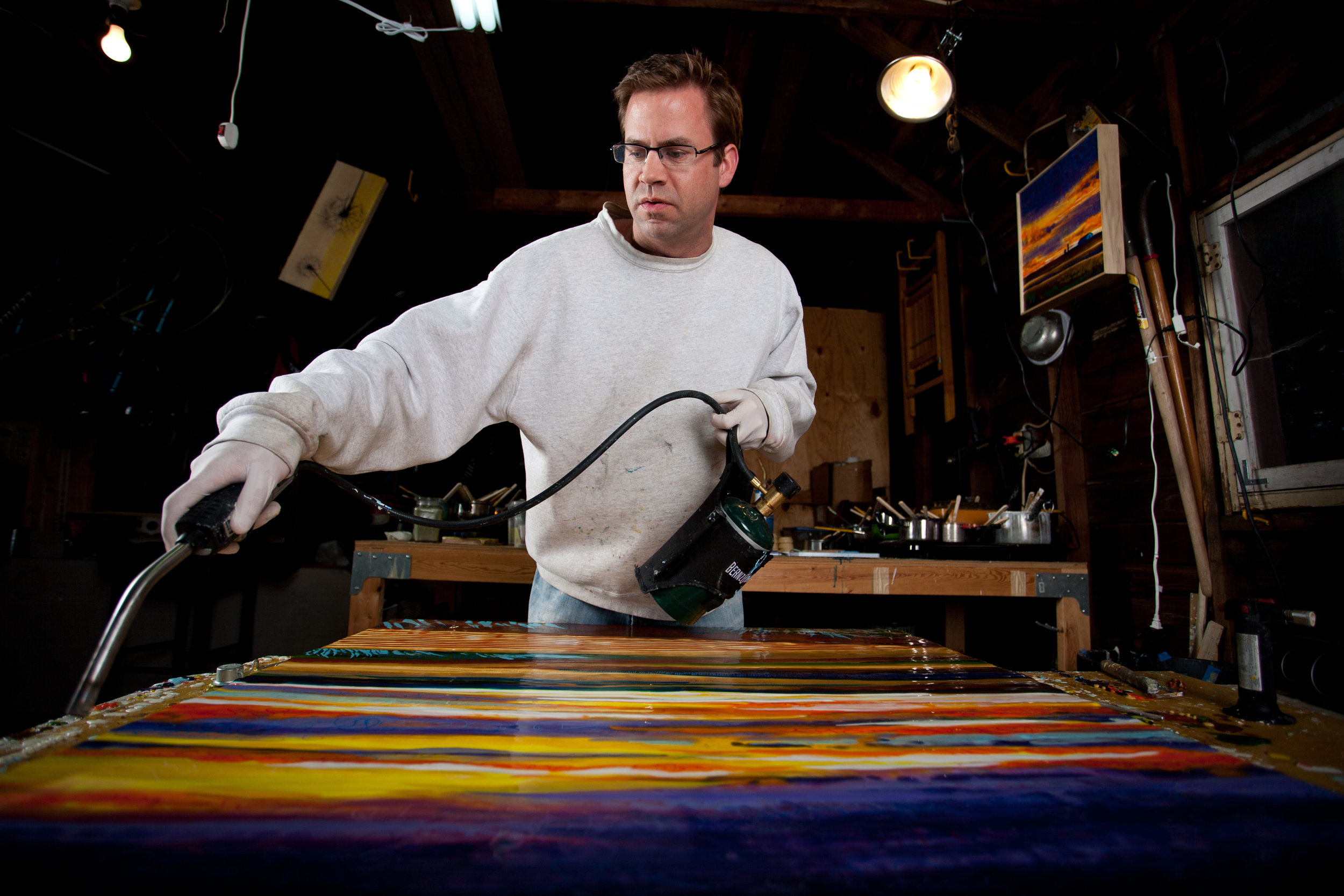 Chris spends his evenings creating new works in his studio garage. Photo by    Zach Johnson